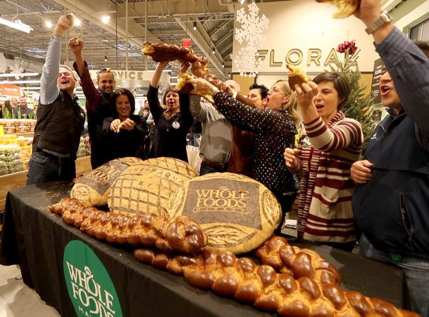 Whole Foods staff members broke a large challah to symbolize the grand opening of the supermarket at Chappaqua Crossing  Dec. 15, 2018. The 40,000 square foot store opened to shoppers on the site of the formers Readers Digest headquarters. The New Castle Town Board and Planning Board approved a temporary traffic plan for the Route 117-Roaring Brook Road intersection that allowed the store to open.