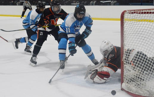 Suffern forward Jake Leale watches the puck deflect just wide in the opening minutes of Friday's game against Mamaroneck.