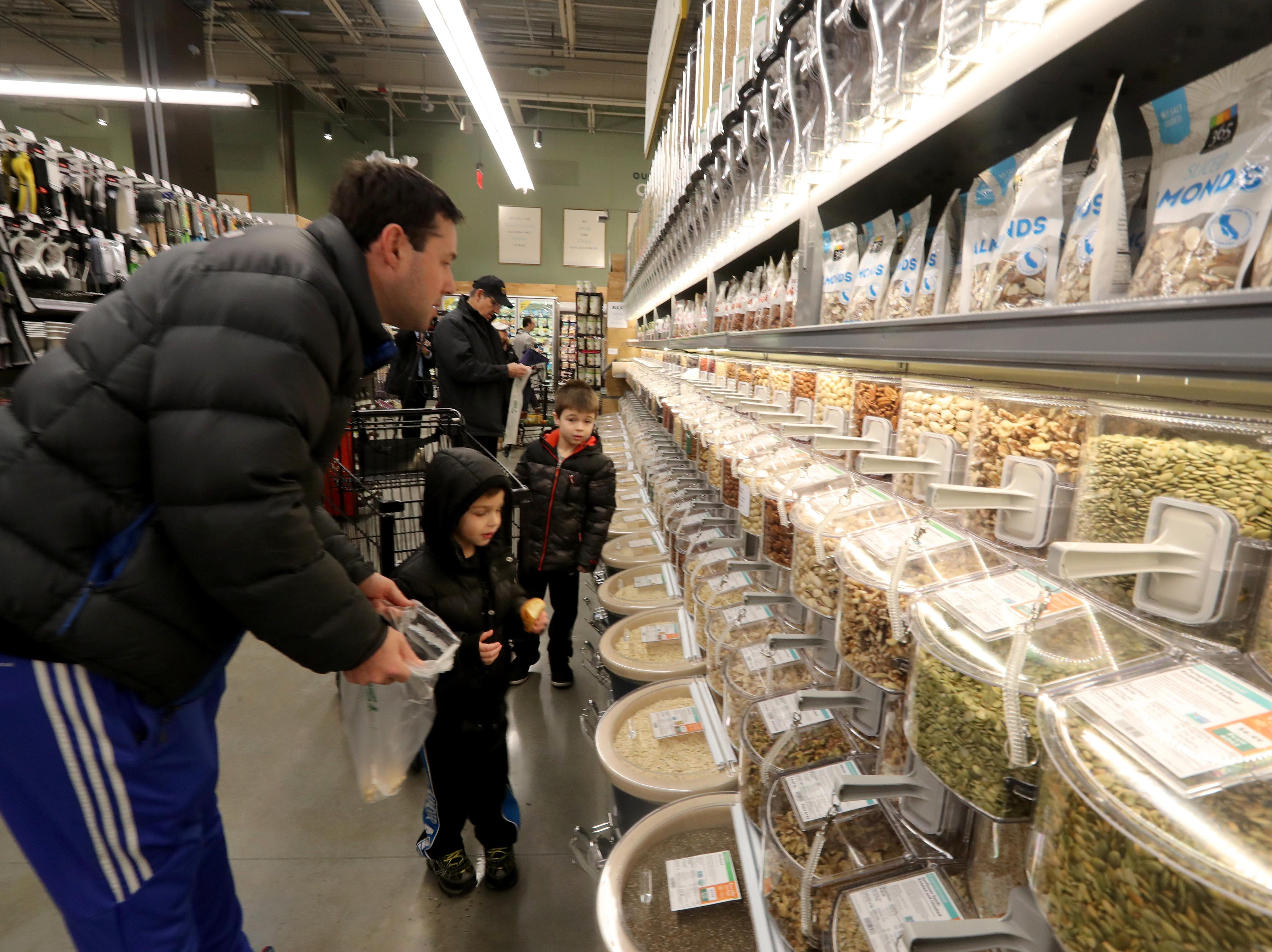Brett Pearlman of Pleasantville and his sons Seth 4, and Russell 6, shop in the new Whole Foods in Chappaqua shortly after the grand opening of the supermarket at Chappaqua Crossing  Dec. 15, 2018. The 40,000 square foot store opened to shoppers on the site of the formers Readers Digest headquarters. The New Castle Town Board and Planning Board approved a temporary traffic plan for the Route 117-Roaring Brook Road intersection that allowed the store to open.
