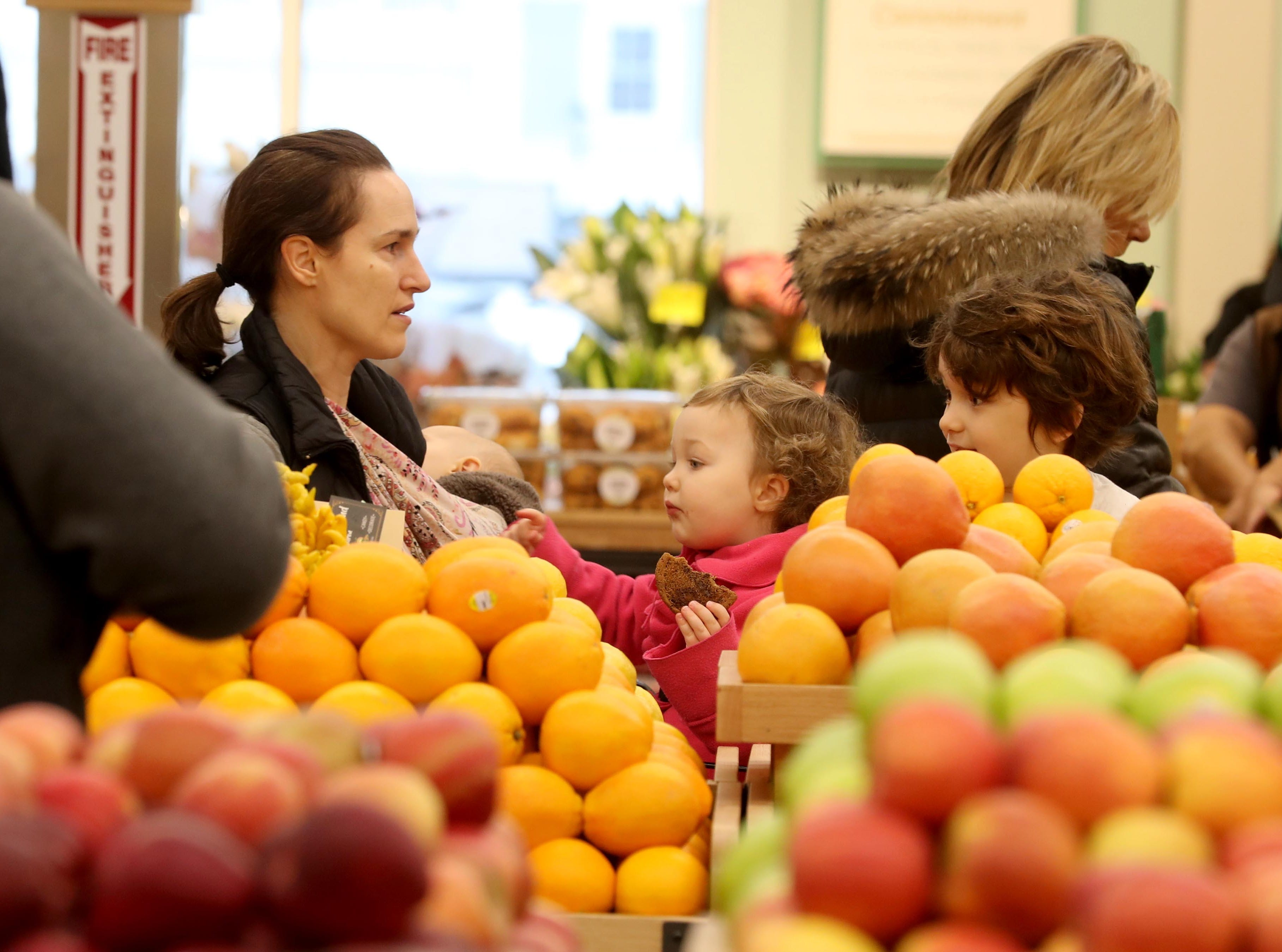 Shoppers make their way through the produce section at the new Whole Foods in Chappaqua Dec. 15, 2018. The 40,000 square foot store opened to shoppers on the site of the formers Readers Digest headquarters. The New Castle Town Board and Planning Board approved a temporary traffic plan for the Route 117-Roaring Brook Road intersection that allowed the store to open.