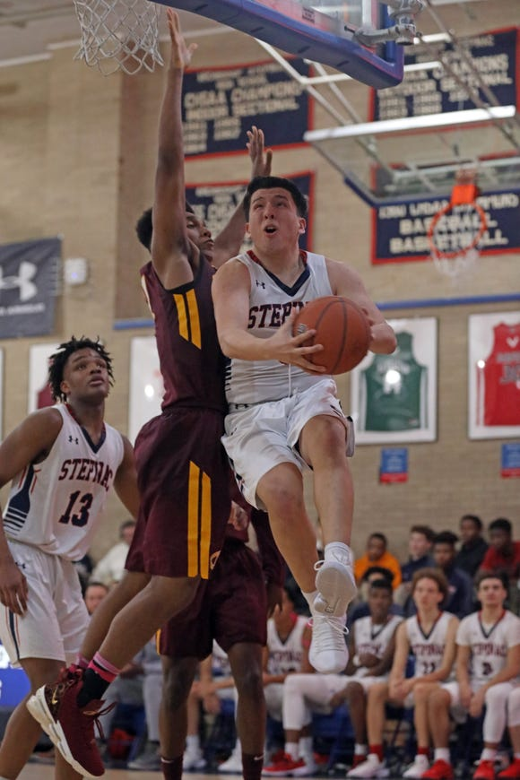 Stepinac 's Eddie Sanchez (3) goes up for two during boys basketball game at Stepinac High School in White Plains Dec.14, 2018, Christ the King defeats Stepinac 85-69.