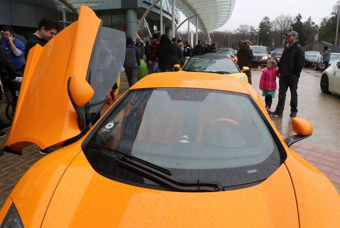 Super cars are lined up outside Nemours/A.I. duPont Hospital for Children Saturday as Cars and Coffee club members show off their exotic vehicles. Hundreds of cars converged on the hospital as car enthusiasts showed off their flashy rides for patients and brought in cartloads of toys for Christmas.