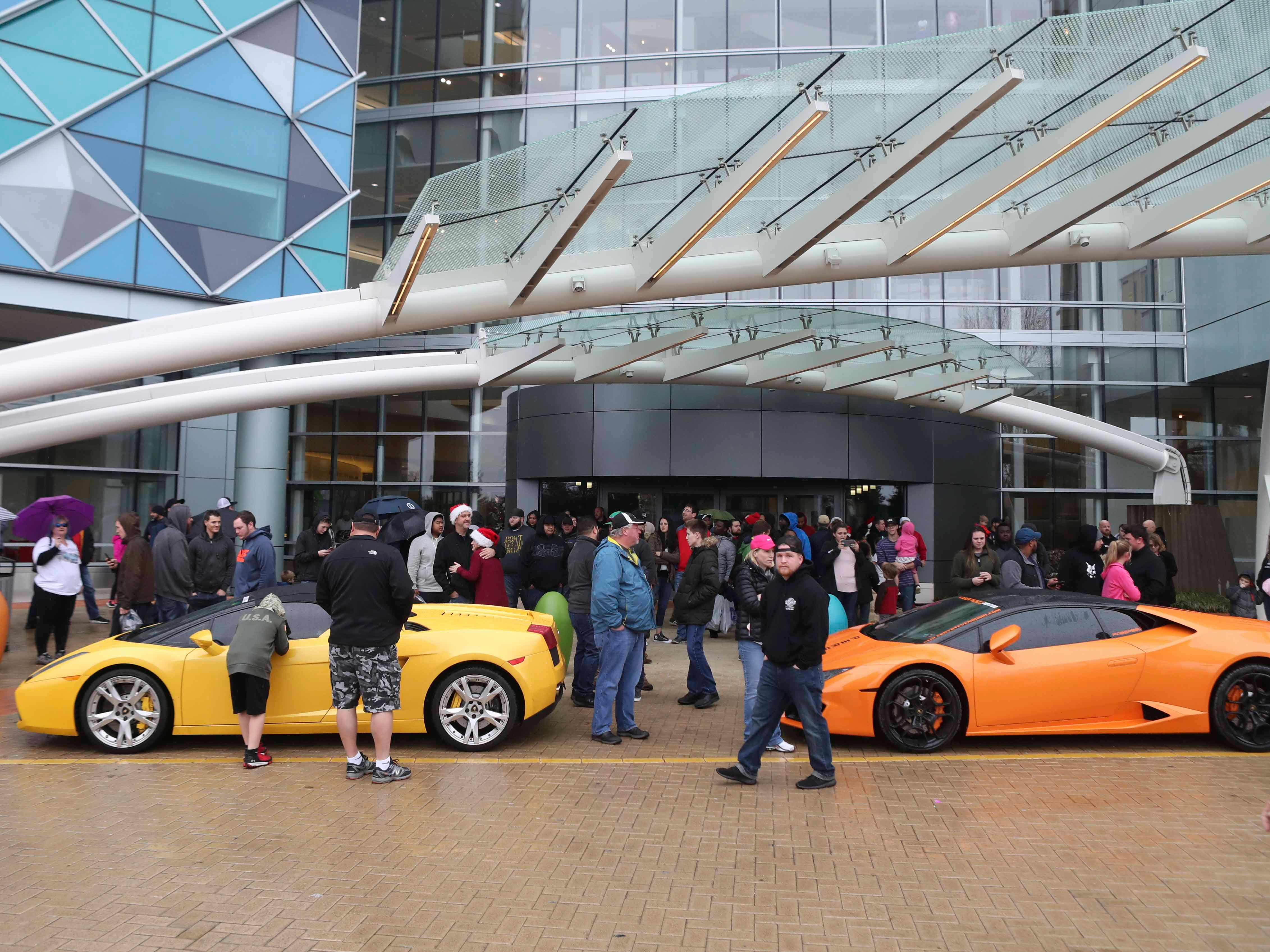 Cars and Coffee club members conduct a toy drive and drive big toys to the Nemours/A.I. duPont Hospital for Children Saturday. Hundreds of cars converged on the hospital as car enthusiasts showed off their flashy rides for patients and brought in cartloads of toys for Christmas.