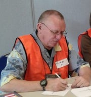 Mike Hoier volunteered for the Volunteer Center's Disaster Volunteer Reception Center.  This photo was taken in 2013 during a spring exercise.