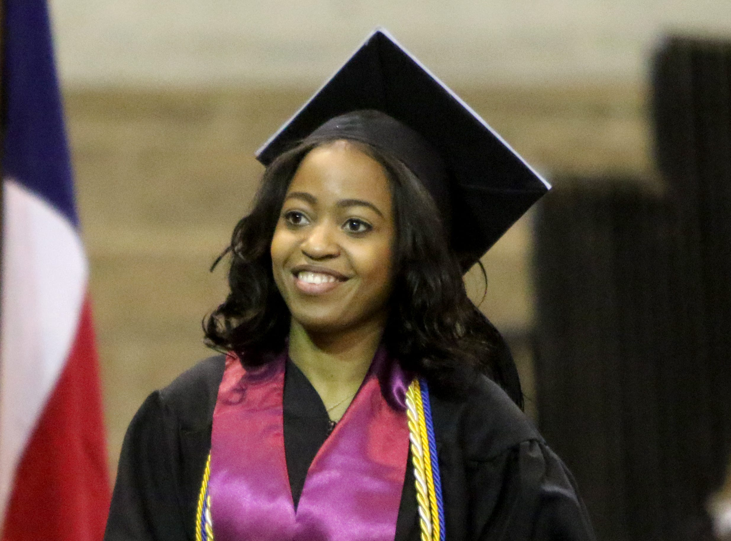 Midwestern State University masters graduate Rolanda Ferdinand walks onto the stage at the fall commencement ceremony Saturday, Dec. 15, 2018, in Kay Yeager Coliseum at the MPEC.
