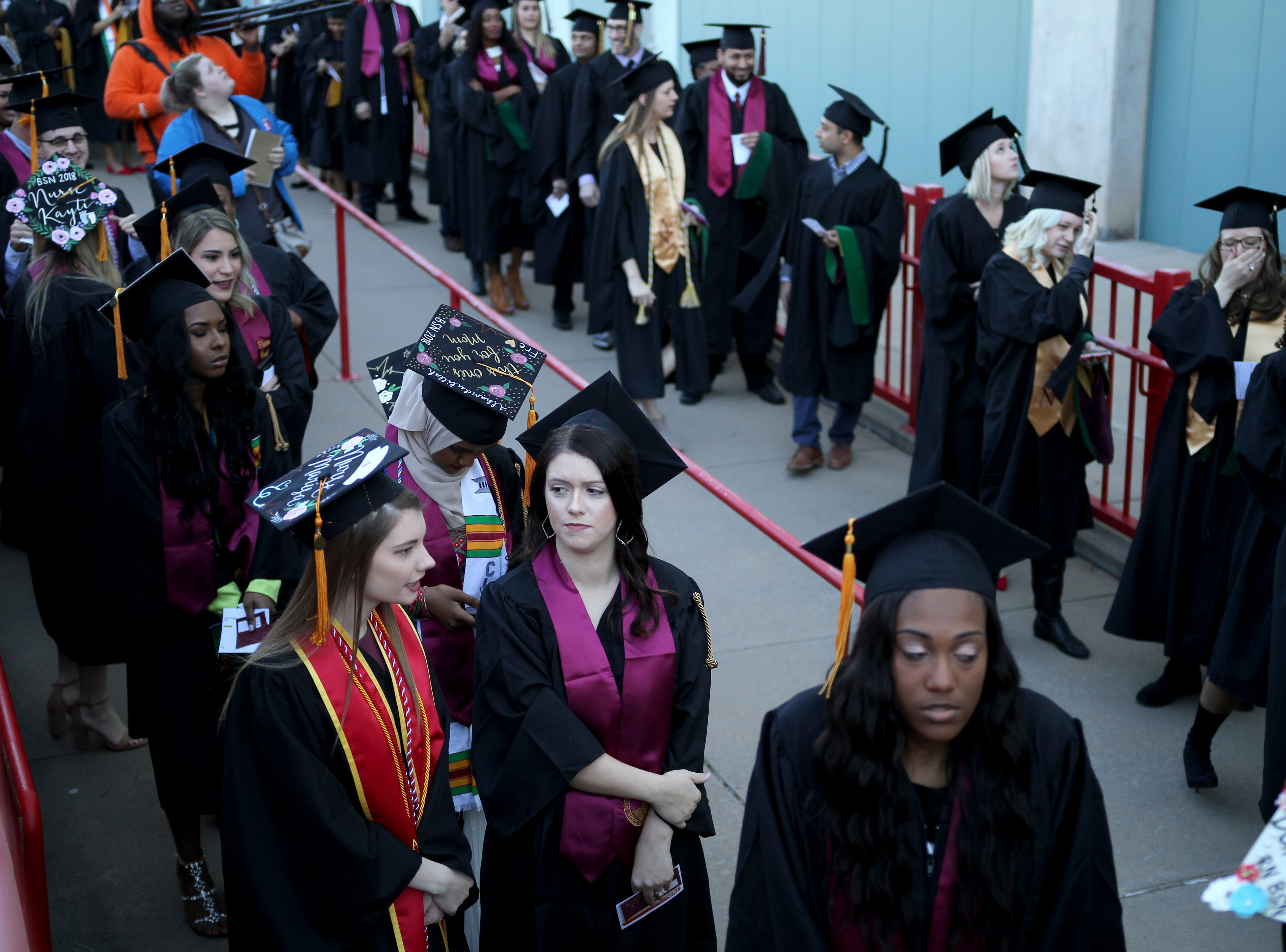 Midwestern State University graduates makes their way inside for the fall commencement ceremony Saturday, Dec. 15, 2018, in Kay Yeager Coliseum at the MPEC.