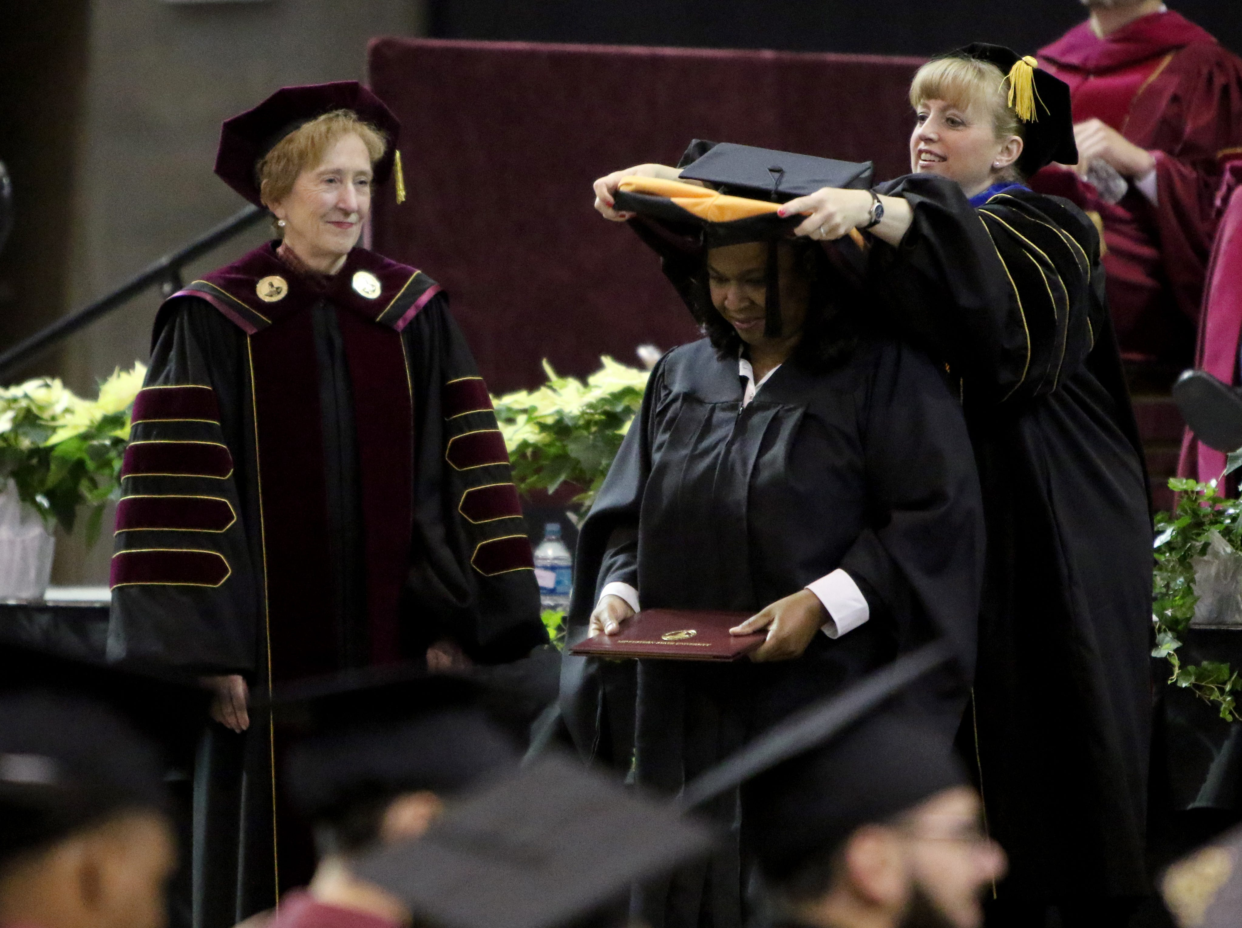 Midwestern State University masters gradatues are hooded at the fall commencement ceremony Saturday, Dec. 15, 2018, in Kay Yeager Coliseum at the MPEC.