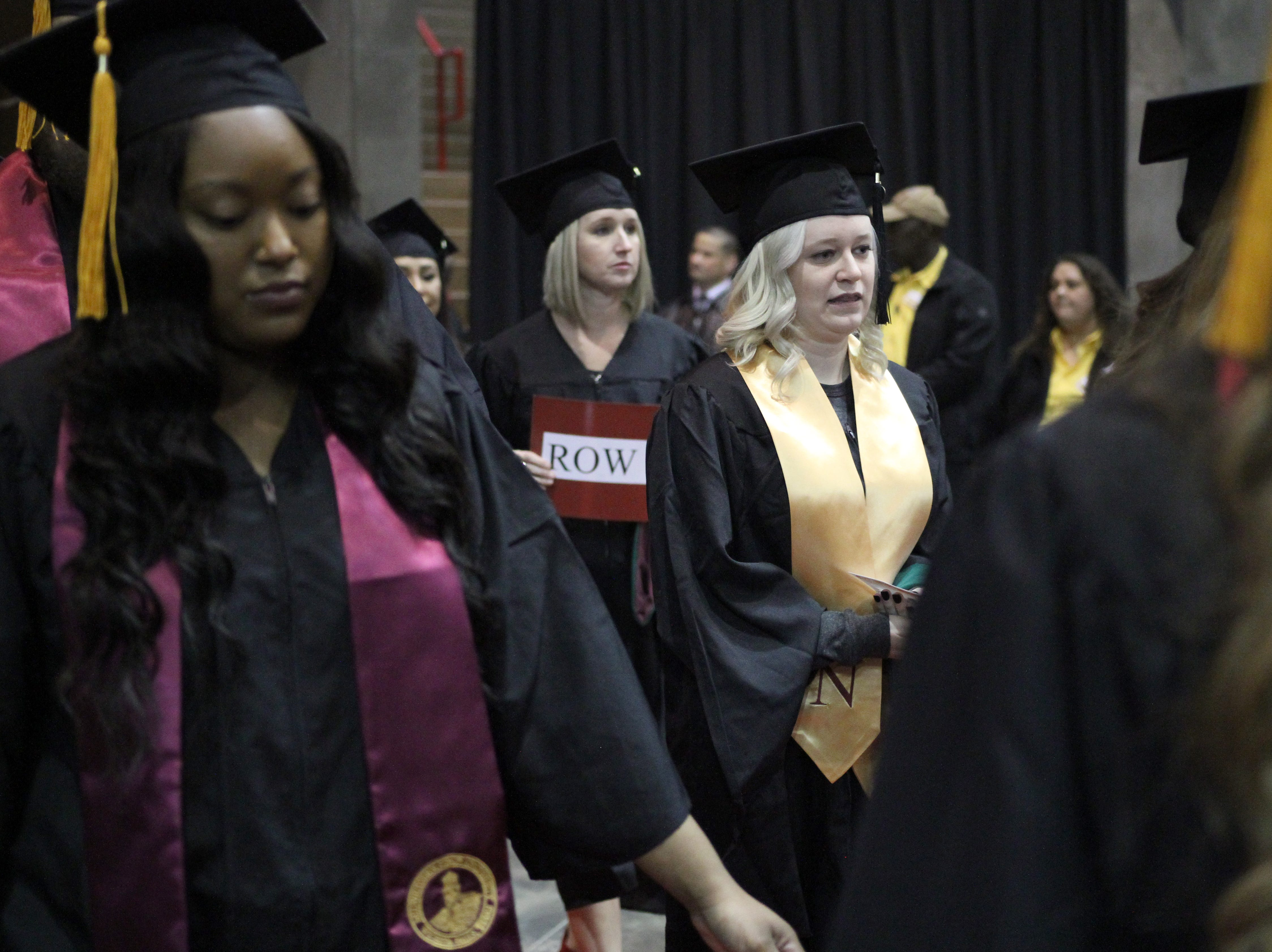Midwestern State University graduates enter during the processional at MSU's fall commencement ceremony Saturday, Dec. 15, 2018, in Kay Yeager Coliseum at the MPEC.