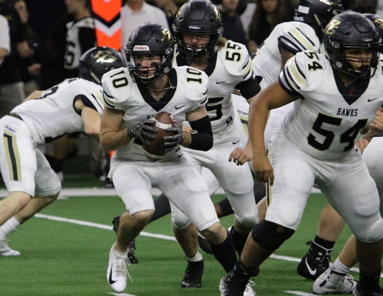 Pleasant Grove's Ben Harmon takes the snap in the Class 4A Division II semifinal against  Iowa Park Friday, Dec. 14, 2018, at the Ford Center in Frisco.