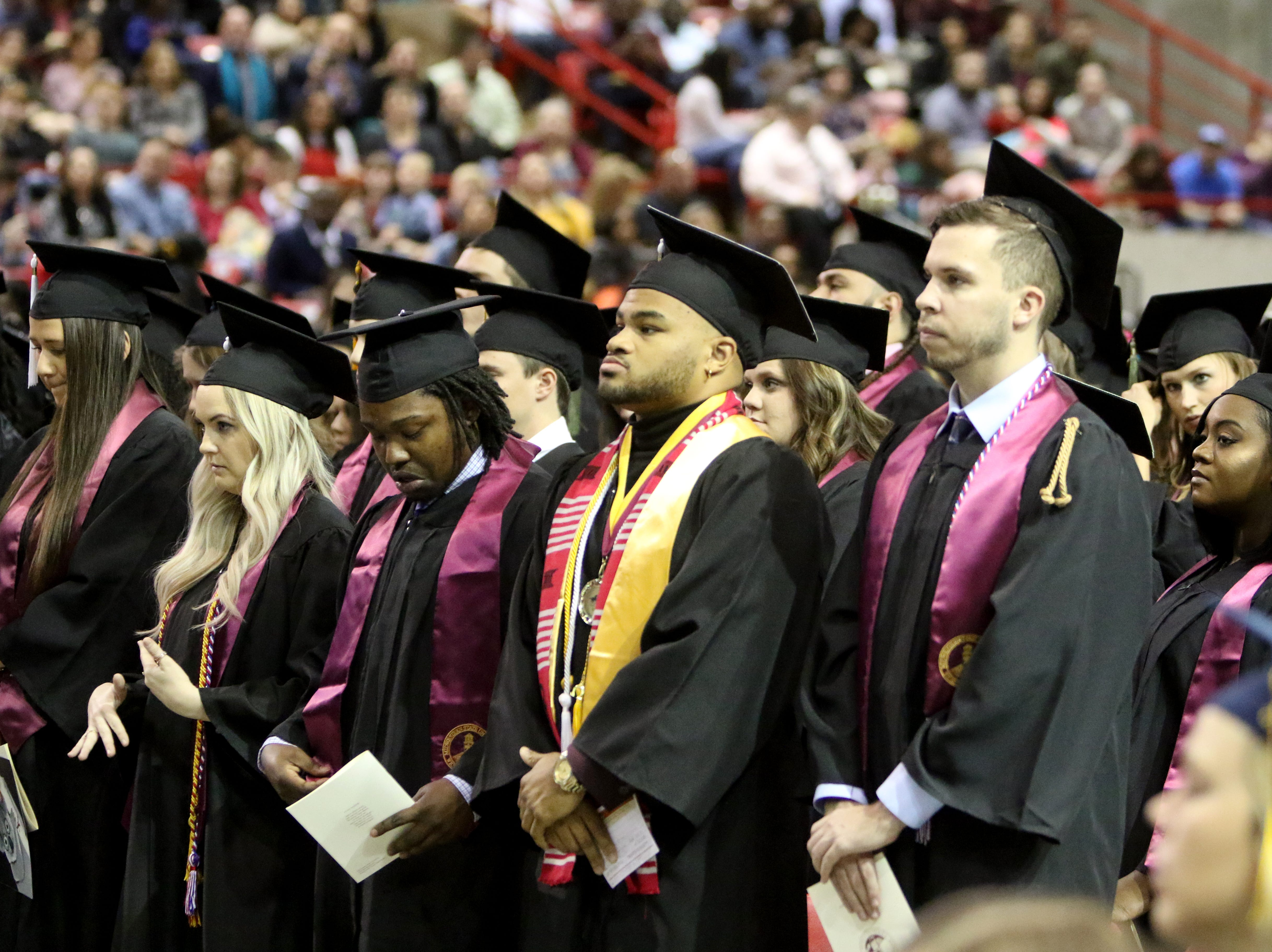 Midwestern State University masters graduates wait as the processional finishes at fall commencement ceremony Saturday, Dec. 15, 2018, in Kay Yeager Coliseum at the MPEC.