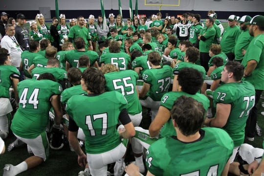 Iowa Park head football coach Aubrey Sims talks to his players after their 49-14 loss to Pleasant Grove in the Class 4A Division II semifinal Friday, Dec. 14, 2018, at the Ford Center in Frisco.