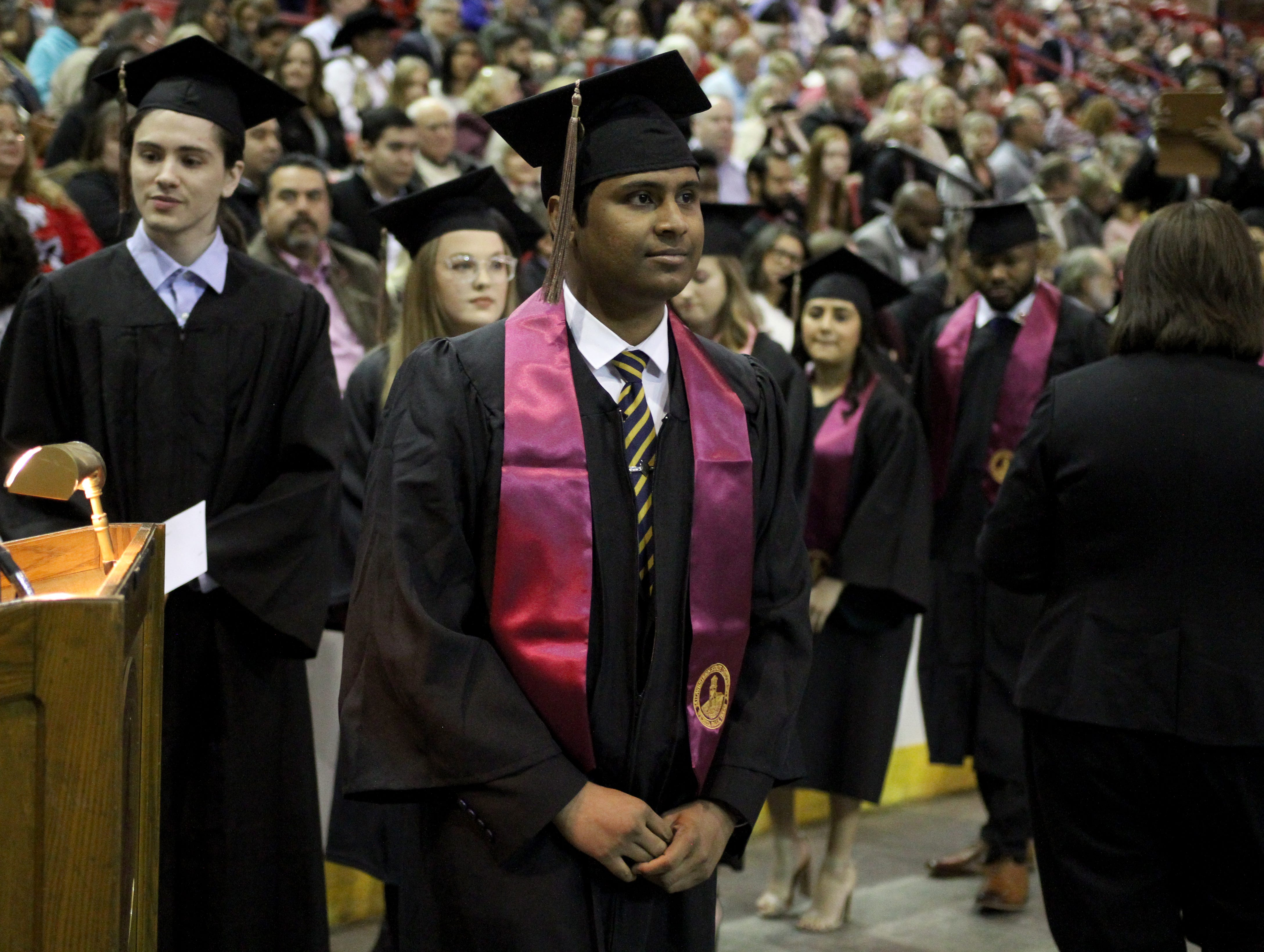 Midwestern State University graduate moves to cross the stage at MSU's fall commencement ceremony Saturday, Dec. 15, 2018, in Kay Yeager Coliseum at the MPEC.