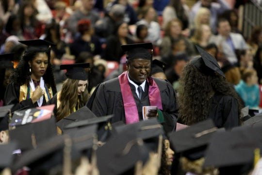 Midwestern State University graduates stand in line as they wait to walk across the stage at the MSU fall commencement ceremony Saturday, Dec. 15, 2018, in Kay Yeager Coliseum at the MPEC.