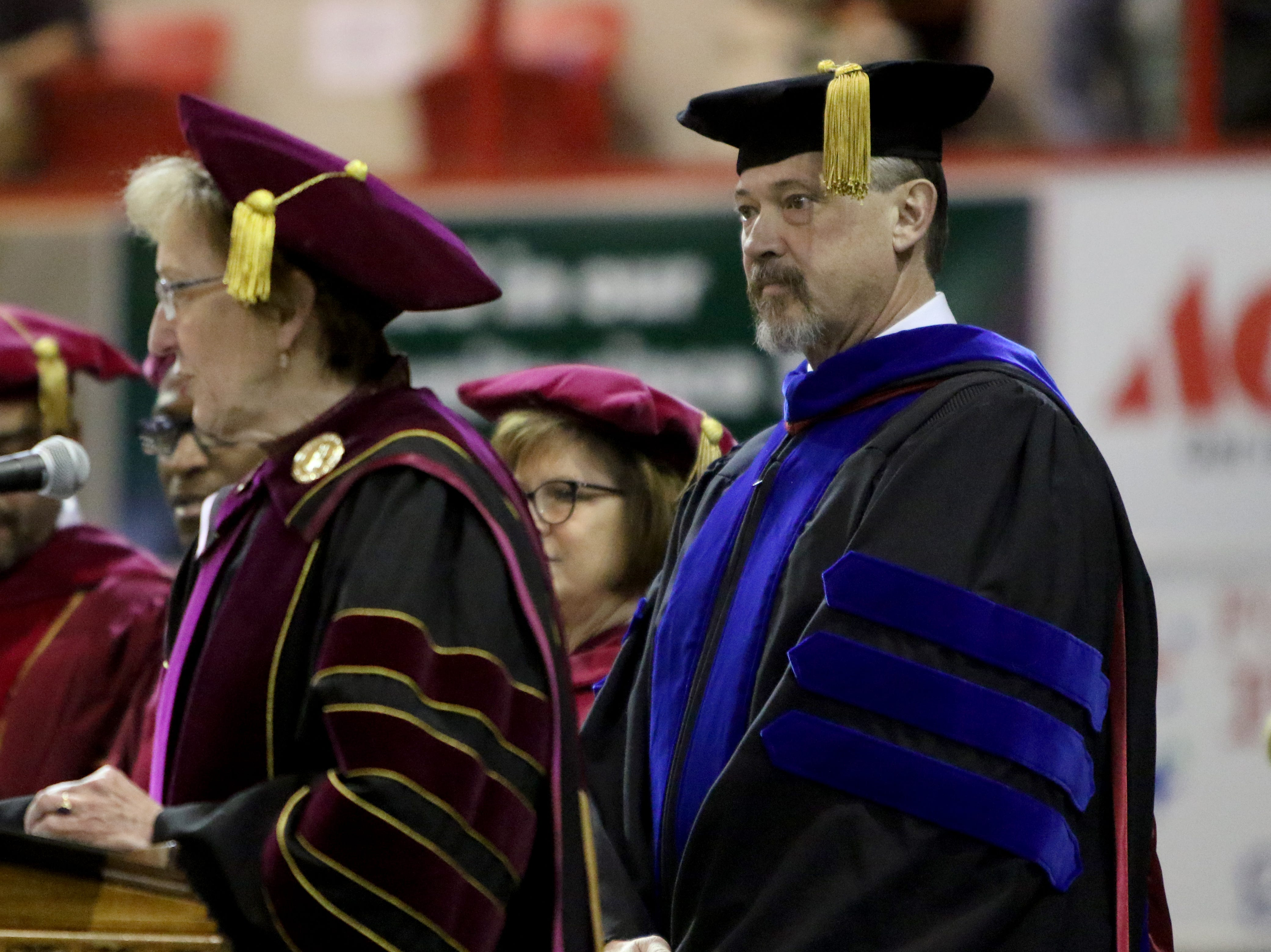 Midwestern State University provost James Johnson waits to give the introductions at fall commencement ceremony Saturday, Dec. 15, 2018, in Kay Yeager Coliseum at the MPEC.