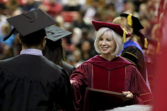 Midwestern State University regent Nancy Marks greets graduates as they cross the stage at the fall commencement ceremony Saturday, Dec. 15, 2018, in Kay Yeager Coliseum at the MPEC.