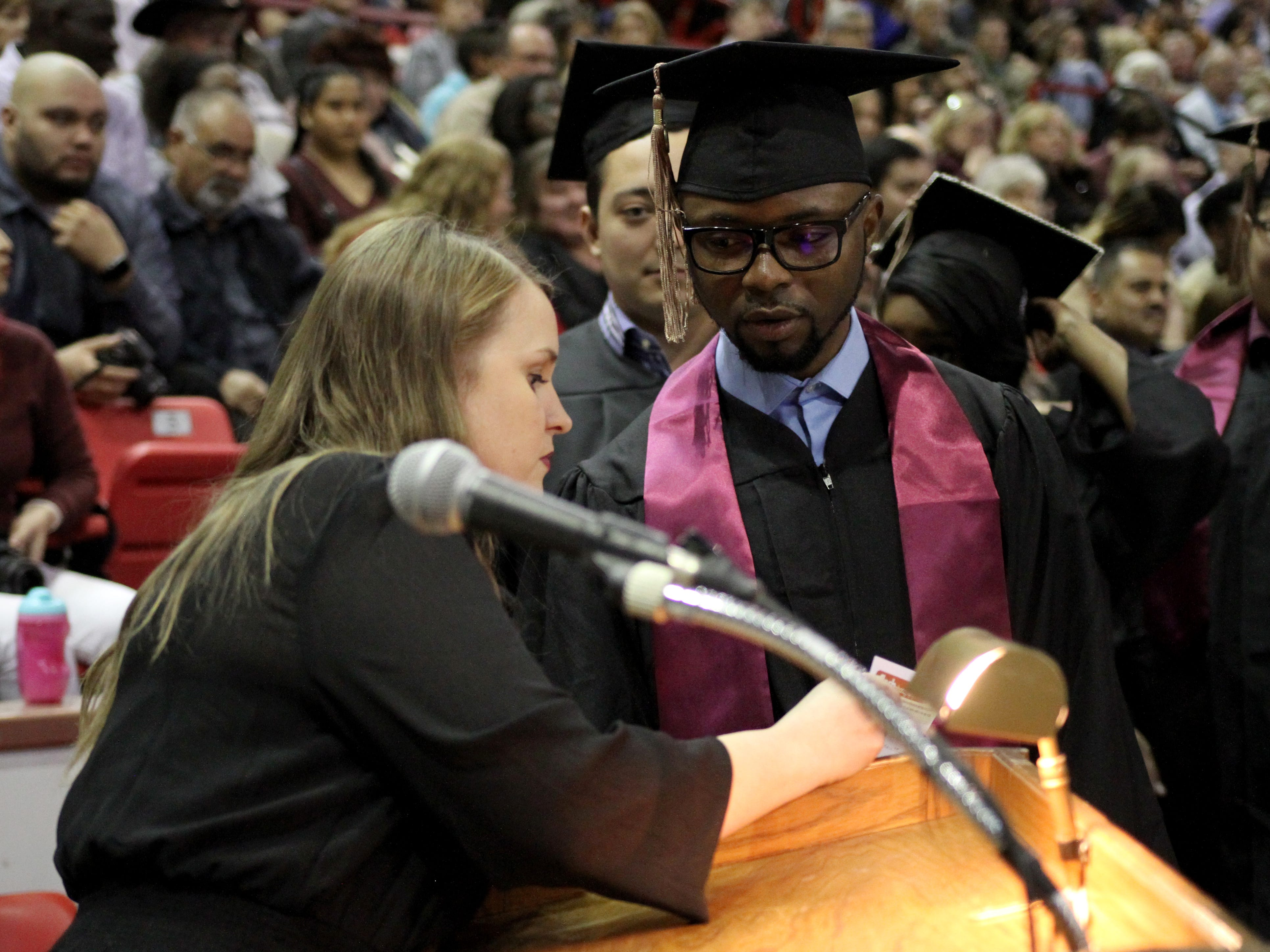 Ann Arnold-Ogden talks with a graduate before he crosses the stage at Midwestern State University's fall commencement ceremony Saturday, Dec. 15, 2018, in Kay Yeager Coliseum at the MPEC.
