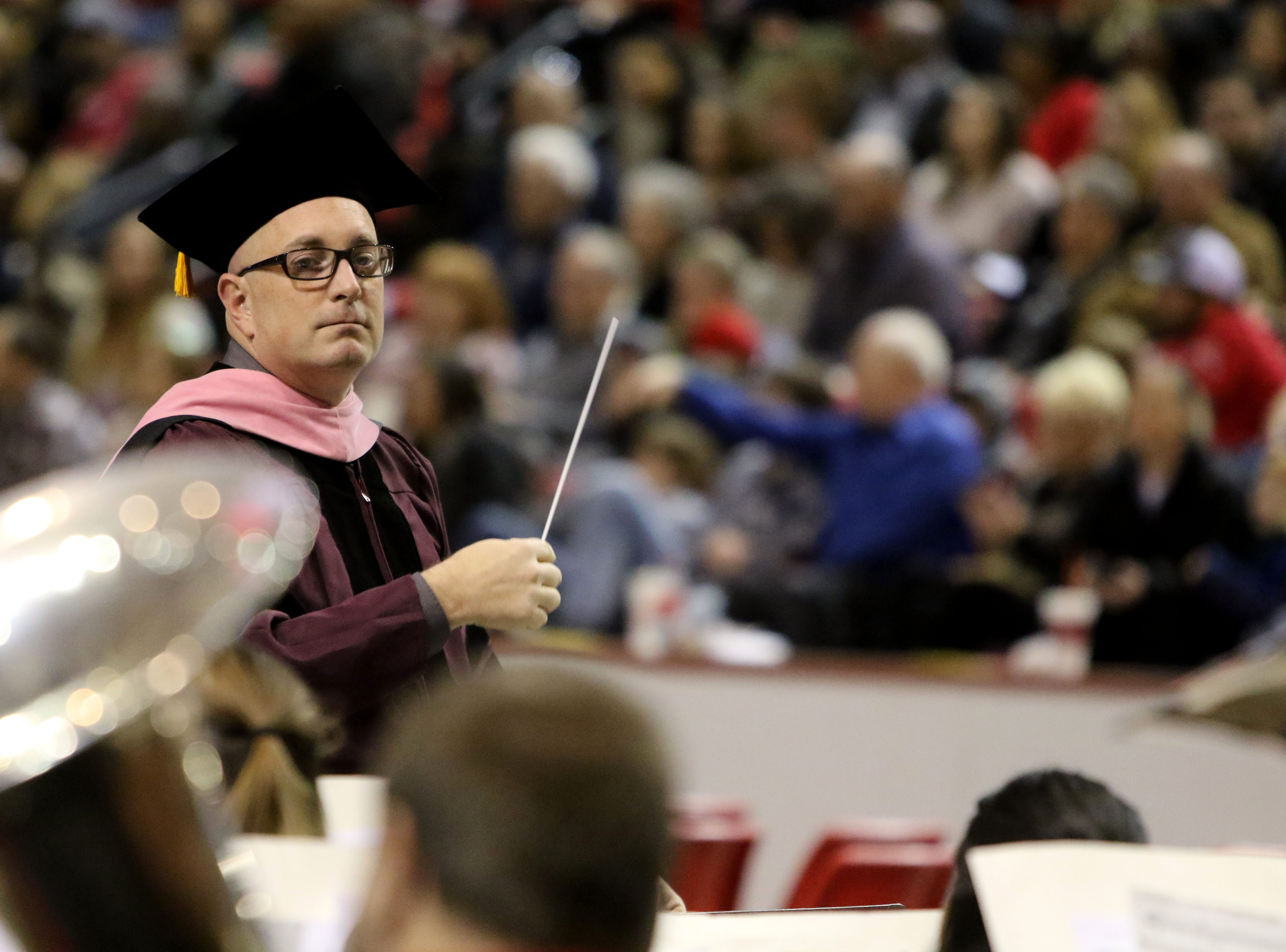"Midwestern State University associate professor of music Matthew Luttrell conducts the ensemble playing ""Pomp and Circumstance, No. 1"" at the MSU fall commencement ceremony Saturday, Dec. 15, 2018, in Kay Yeager Coliseum at the MPEC."