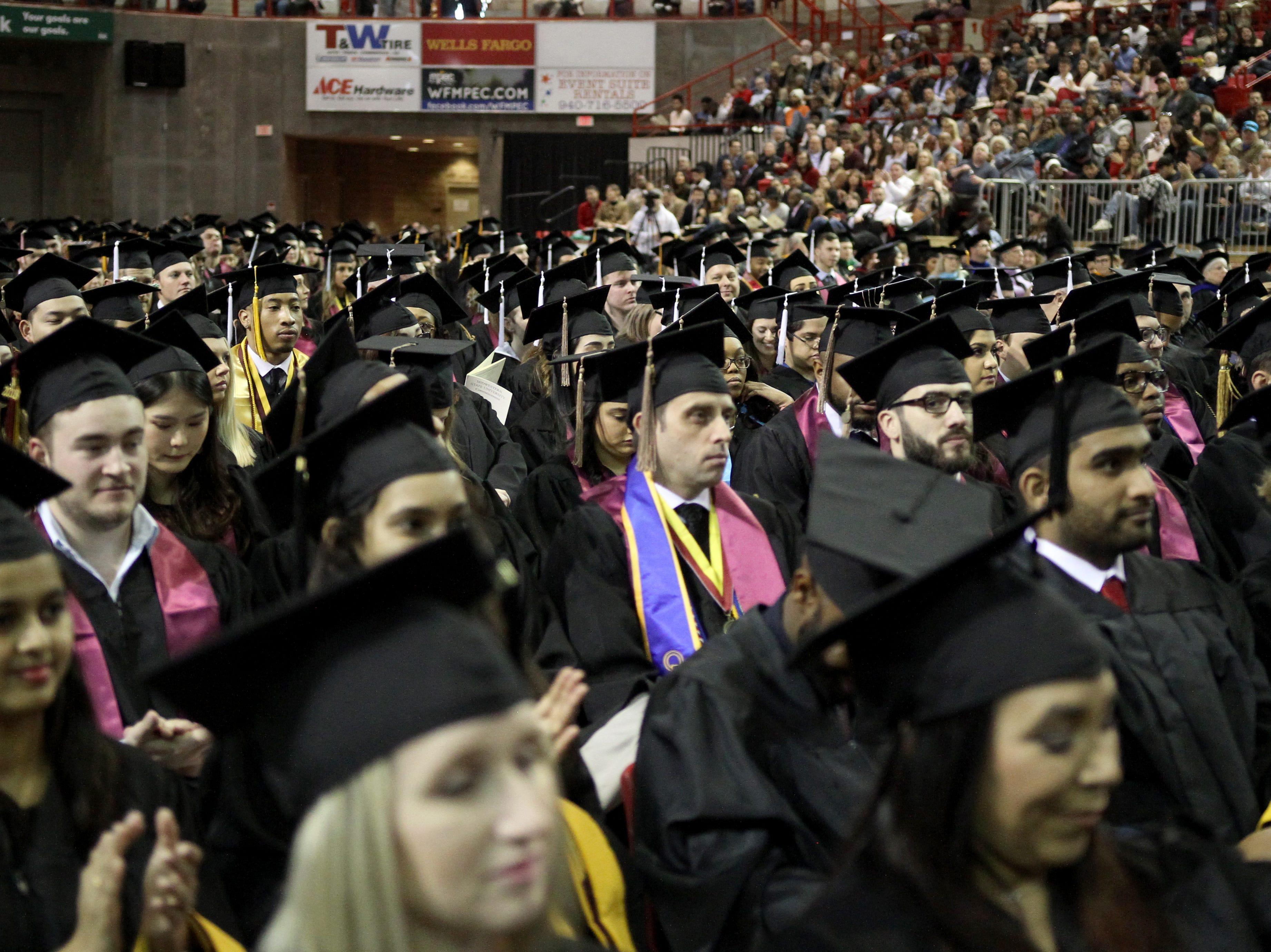 Midwestern State University graduates listen to the commencement address at the fall commencement ceremony Saturday, Dec. 15, 2018, in Kay Yeager Coliseum at the MPEC.