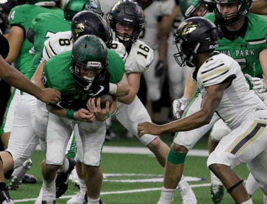 Iowa Park's Brendin Fallon is tackled by Pleasant Grove's Caleb Hemphill in Friday's 49-14 setback.