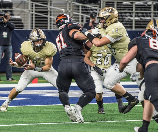 Rider sophomore quarterback Jacob Rodriguez tries to corral a snap with Aledo sophomore Oliver Crow in pursuit while Rider sophomore Lance Ausmus tries to block him during a Class 5A Division II semifinal game at AT&T Stadium in Arlington.