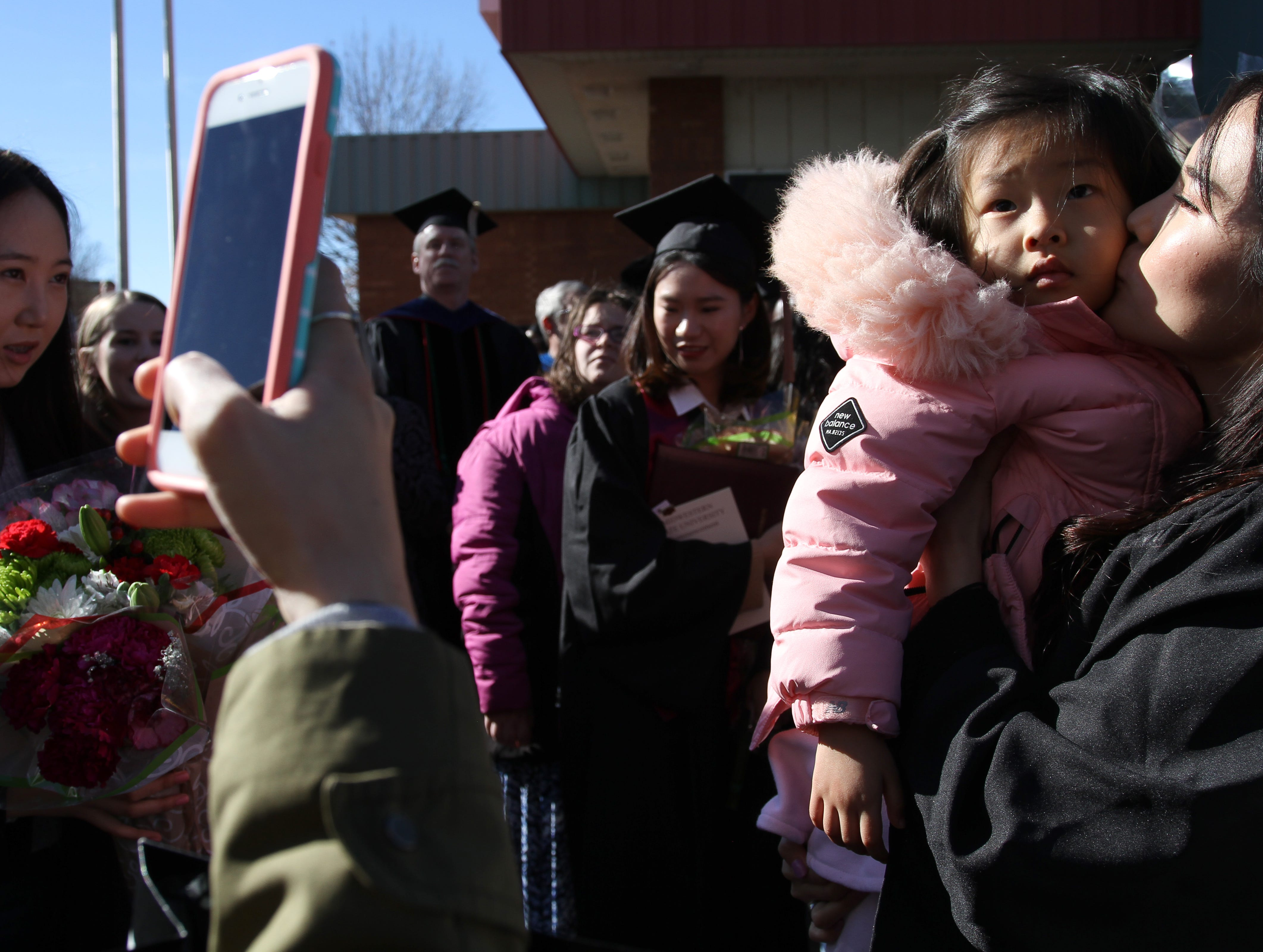 Midwestern State University graduate Sunyul Lee has her photo taken with her niece Diana after MSU's fall commencement ceremony Saturday, Dec. 15, 2018, in Kay Yeager Coliseum at the MPEC.