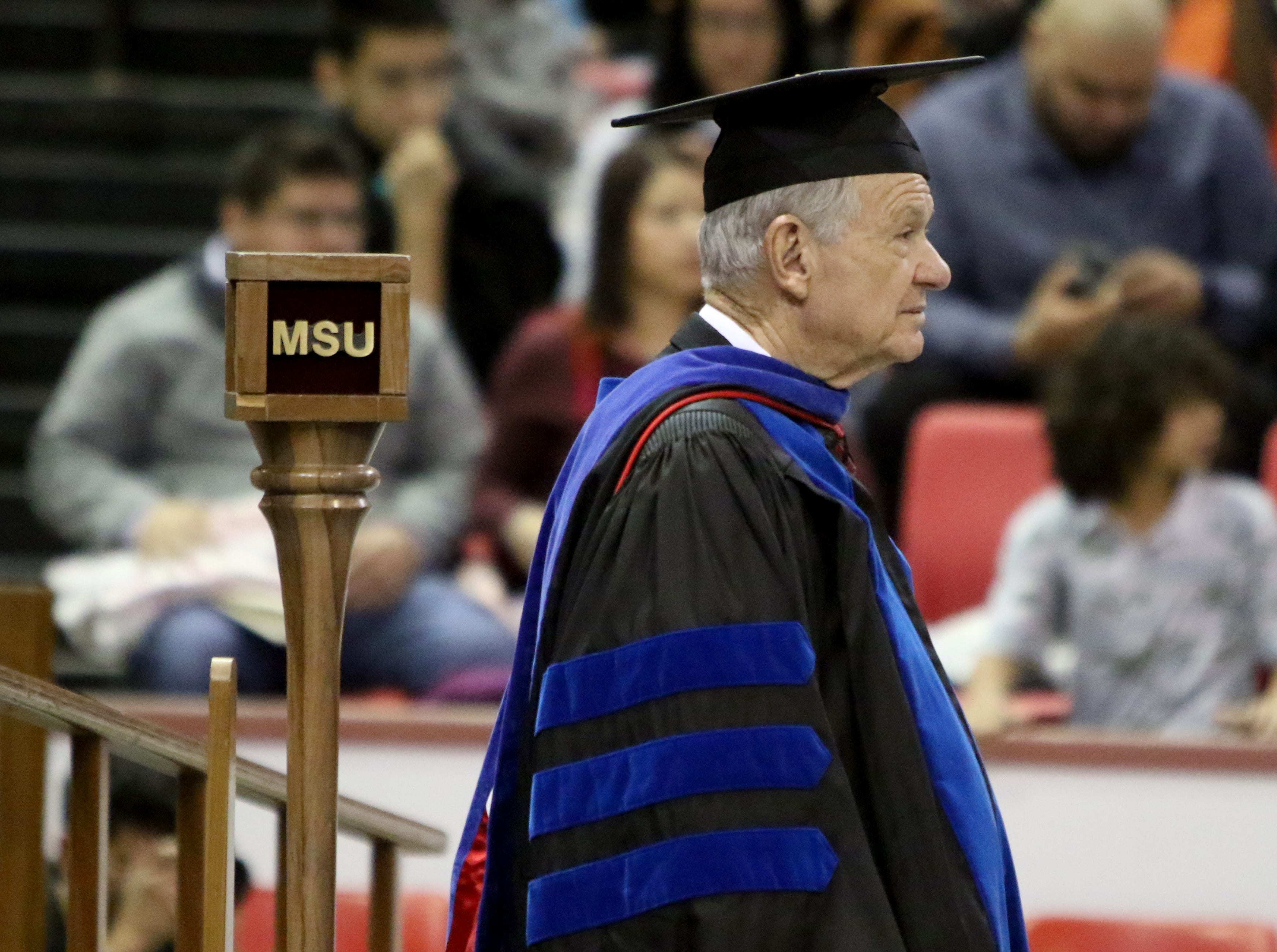 Midwestern State University history professor Harry Hewitt takes part in his final fall commencement ceremony Saturday, Dec. 15, 2018, in Kay Yeager Coliseum at the MPEC. Hewitt is MSU's longest serving professor at 51 years and is retiring.