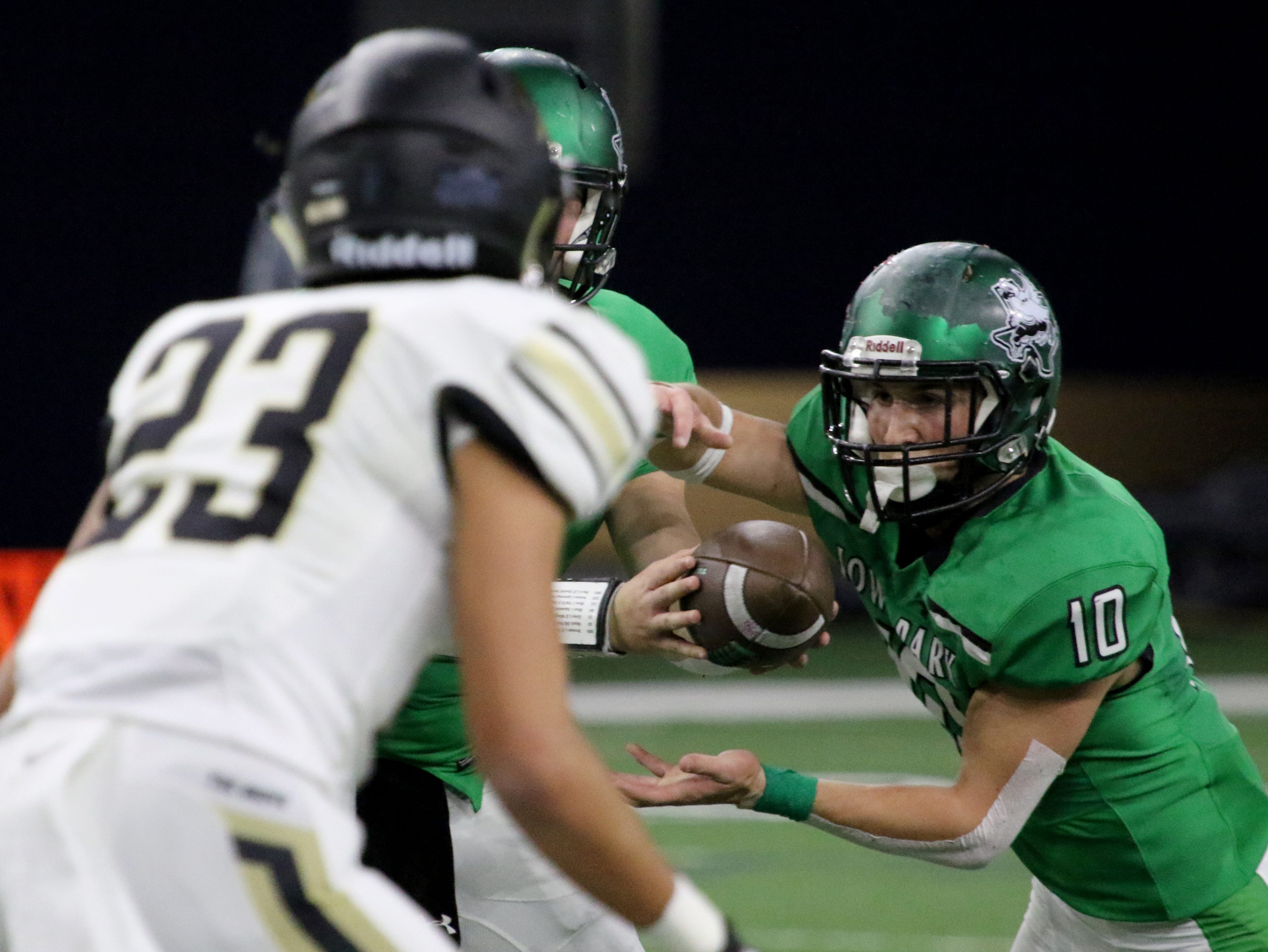 Iowa Park's Brendin Fallon takes the handoff in the Class 4A Division II semifinal against  Pleasant Grove Friday, Dec. 14, 2018, at the Ford Center in Frisco.