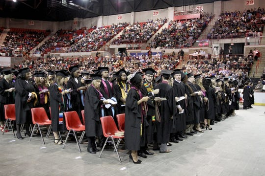 Midwestern State University graduates wait as the processional finishes at fall commencement ceremony Saturday, Dec. 15, 2018, in Kay Yeager Coliseum at the MPEC.