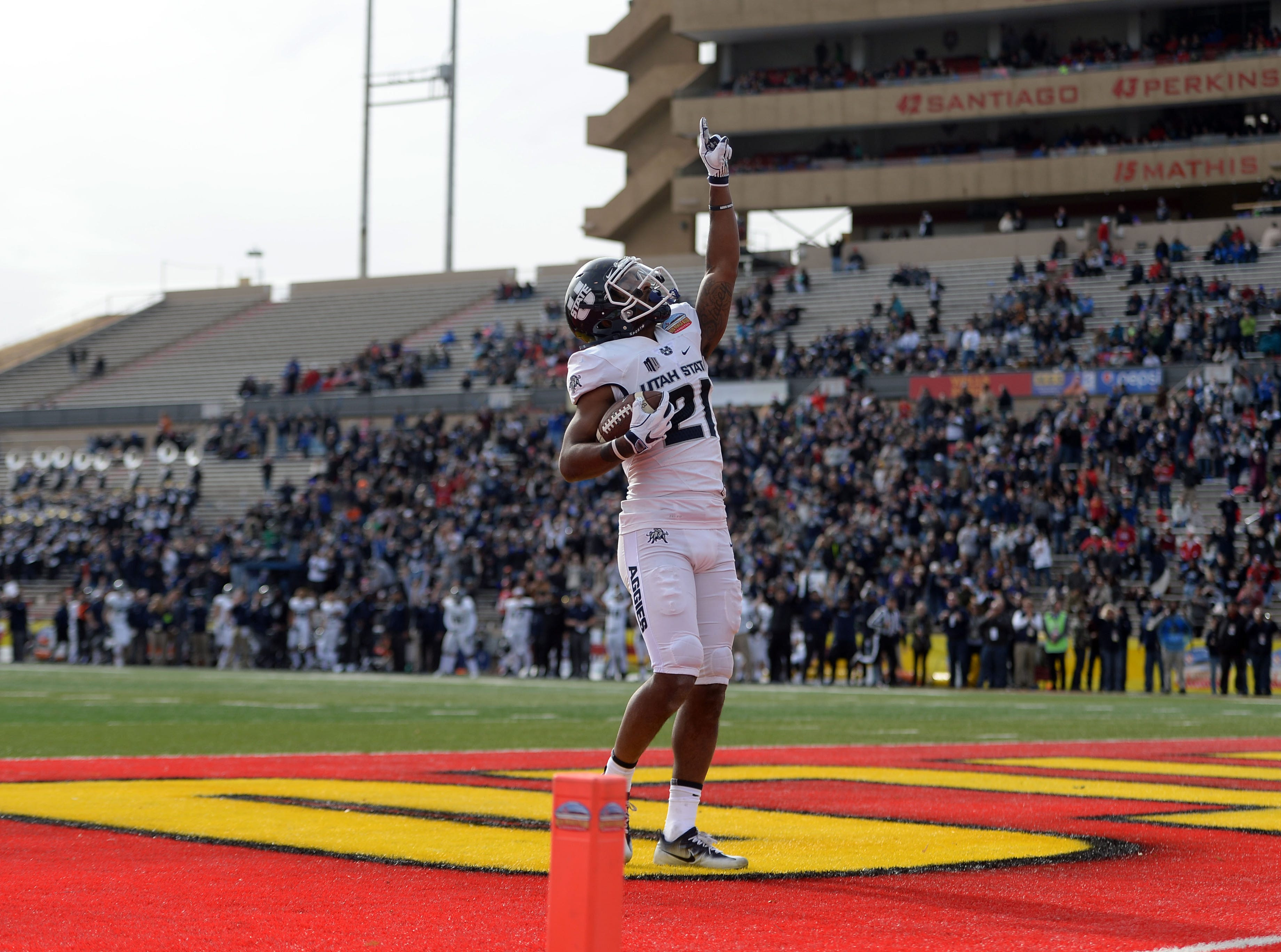 Utah State Aggies wide receiver Jalen Greene (21) celebrates a touchdown against the North Texas Mean Green in the New Mexico Bowl.