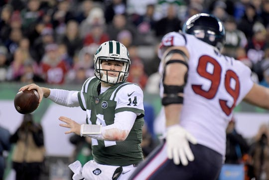 New York Jets quarterback Sam Darnold (14) is pressured by Houston Texans defensive end J.J. Watt (99) during the first half at MetLife Stadium.