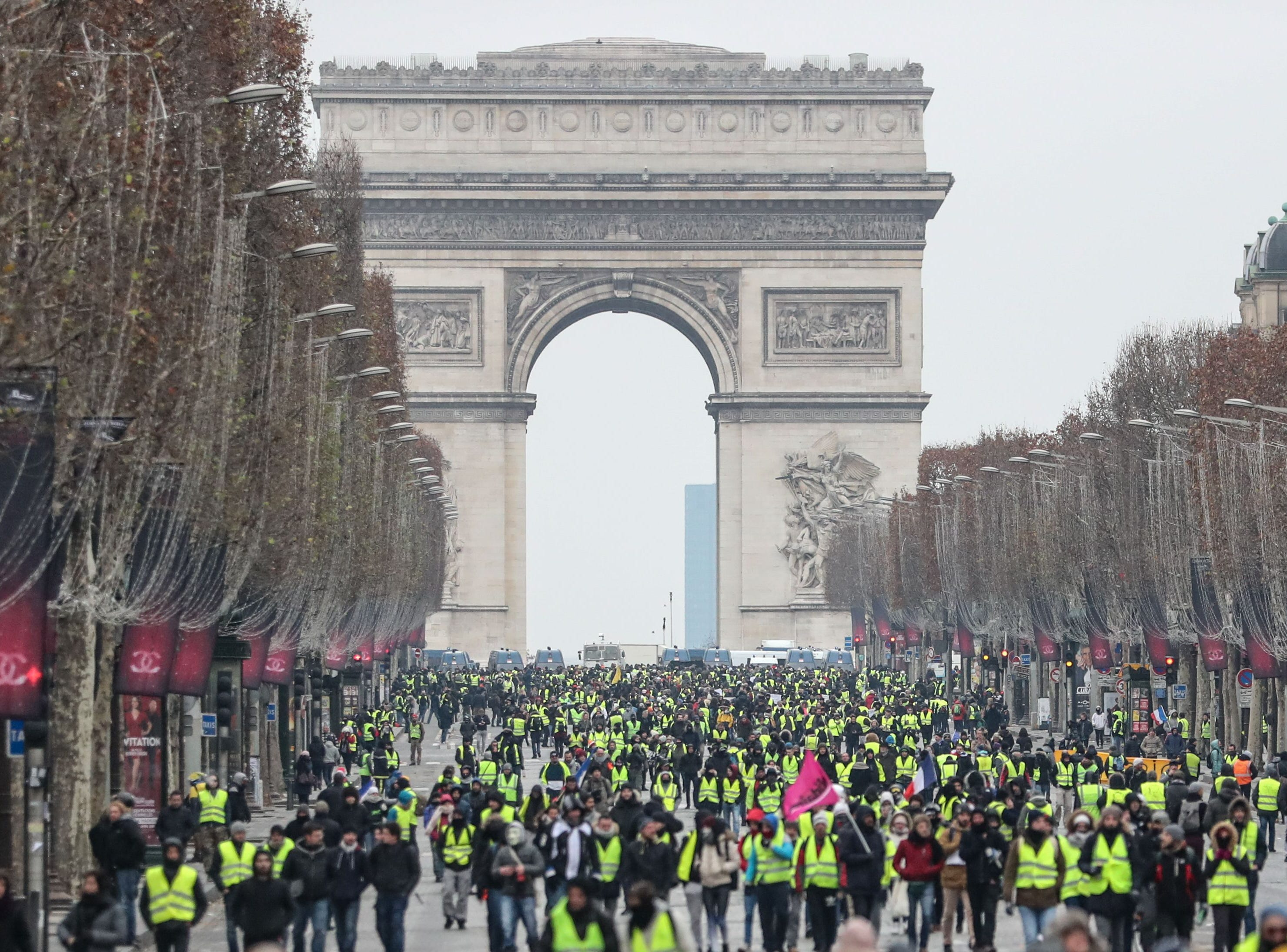 Protesters wearing yellow vests (gilets jaunes) take part in a demonstration on the Champs Elysees Avenue by the Arc de Triomphe in Paris, on Dec. 15, 2018, to protest against rising costs of living they blame on high taxes.