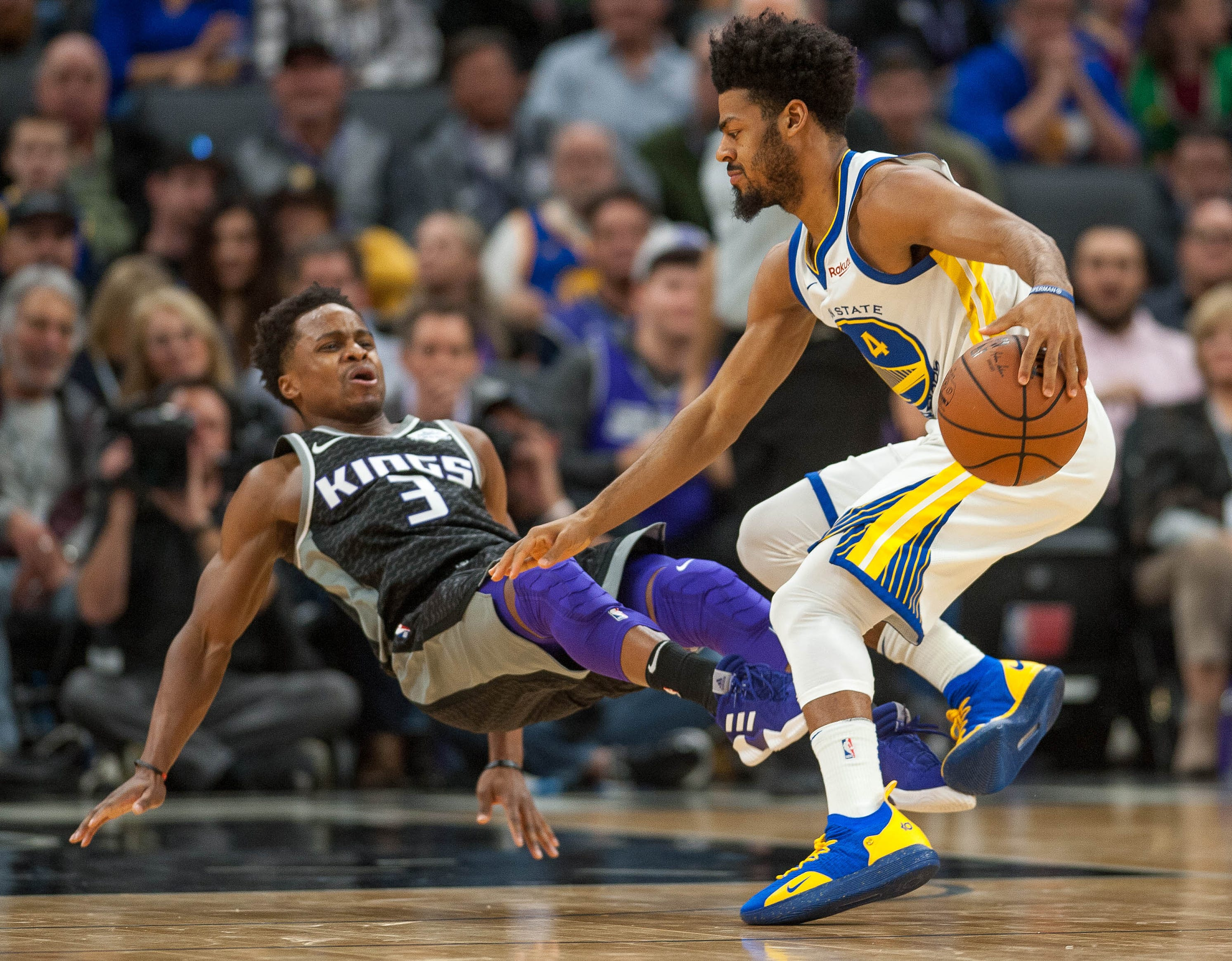 Dec. 14: Kings guard Yogi Ferrell (3) falls to the floor while defending Warriors guard Quinn Cook (4) on the perimeter during the fourth quarter in Sacramento.