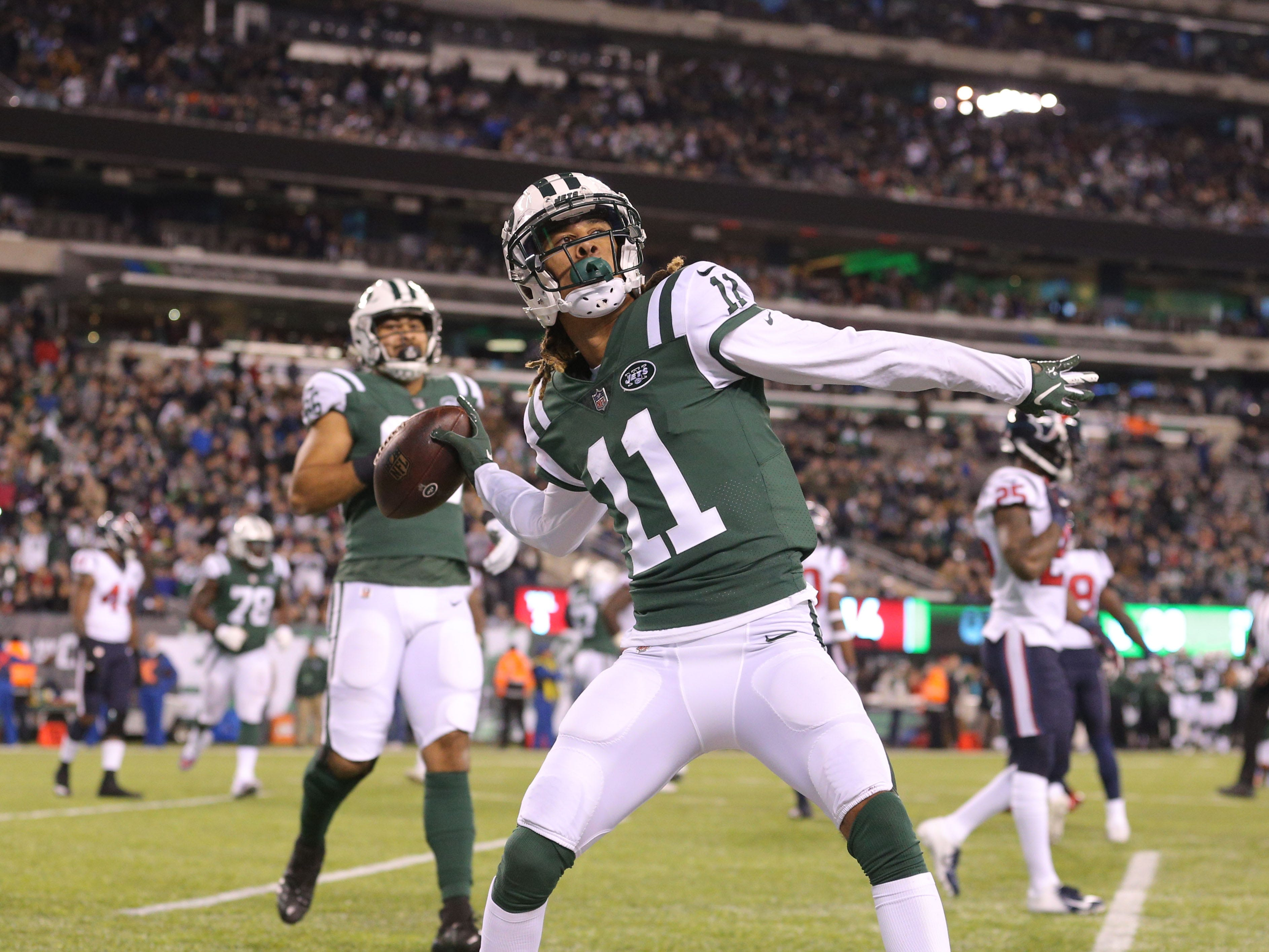 New York Jets wide receiver Robby Anderson (11) celebrates his touchdown against the Houston Texans during the second quarter at MetLife Stadium.