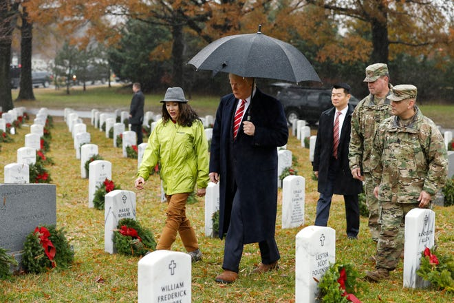 President Donald J. Trump (C) visits Section 60 at Arlington National Cemetery in Arlington, Va., December 15, 2018. Section 60, is the burial ground in the cemetery where military personnel killed in the Global War on Terror since 2001 are interred.