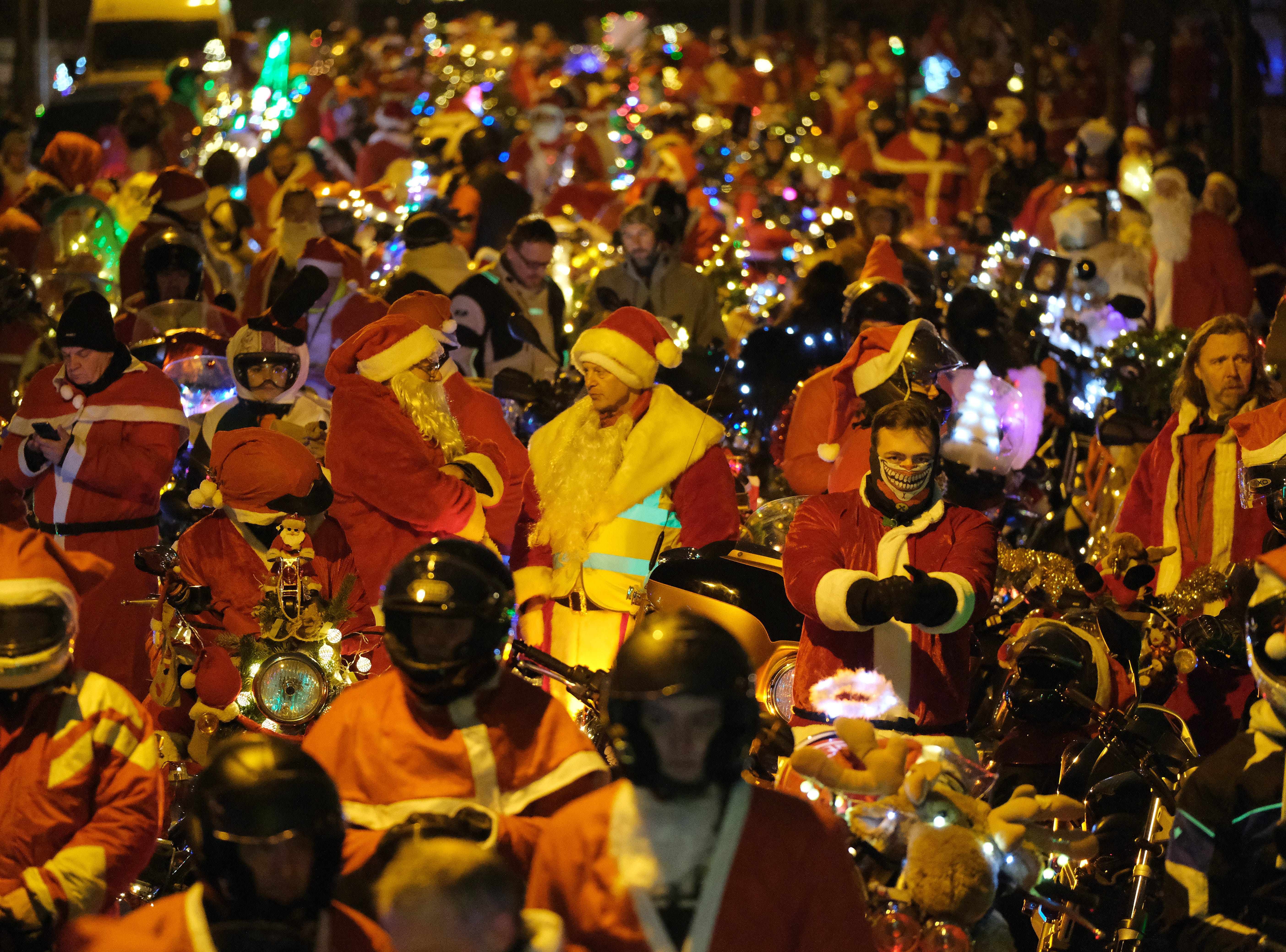 """Motorcycle enthusiasts dressed as Santa Claus prepare to ride in the 21st """"Berlin Christmas Biketour"""" on Dec.15, 2018 in Berlin, Germany. Several hundred motorcyclists dressed as Santa and angels rode motorcycles decorated with Christmas lights across the city in an annual fundraiser for the needy."""