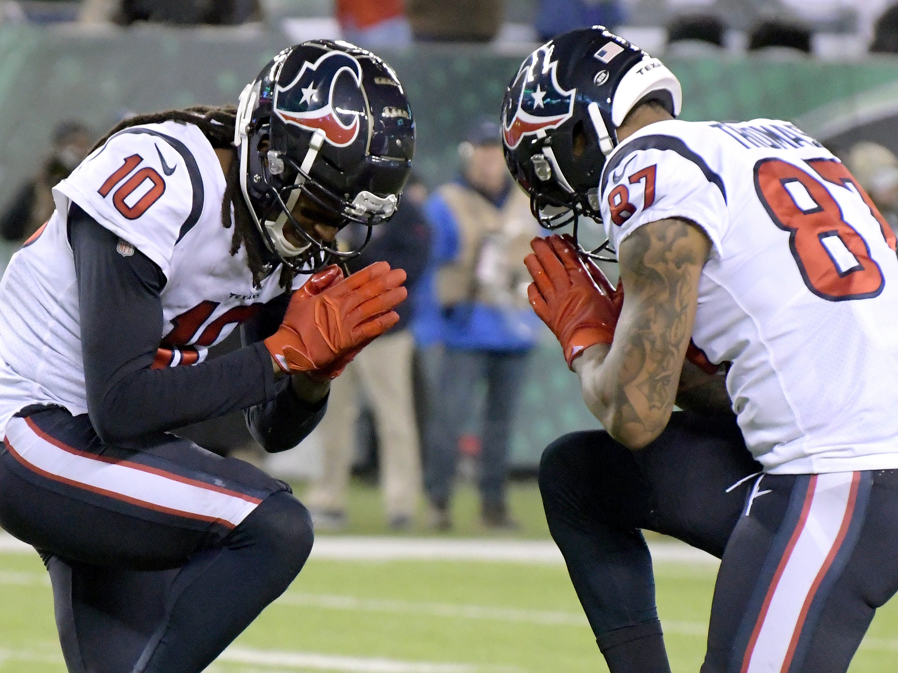 Houston Texans wide receiver DeAndre Hopkins (10) celebrates his touchdown catch with wide receiver Demaryius Thomas (87) during the first half of an NFL football game, Saturday, Dec. 15, 2018, in East Rutherford, N.J.