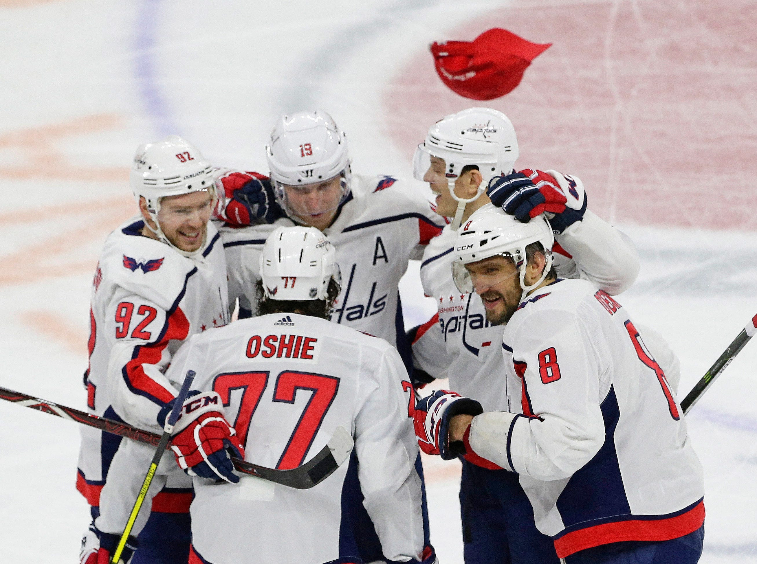 Dec. 14: Washington Capitals star Alex Ovechkin (8) is congratulated by teammates after scoring his second consecutive hat trick, this time in a 6-5 win against the Carolina Hurricanes.