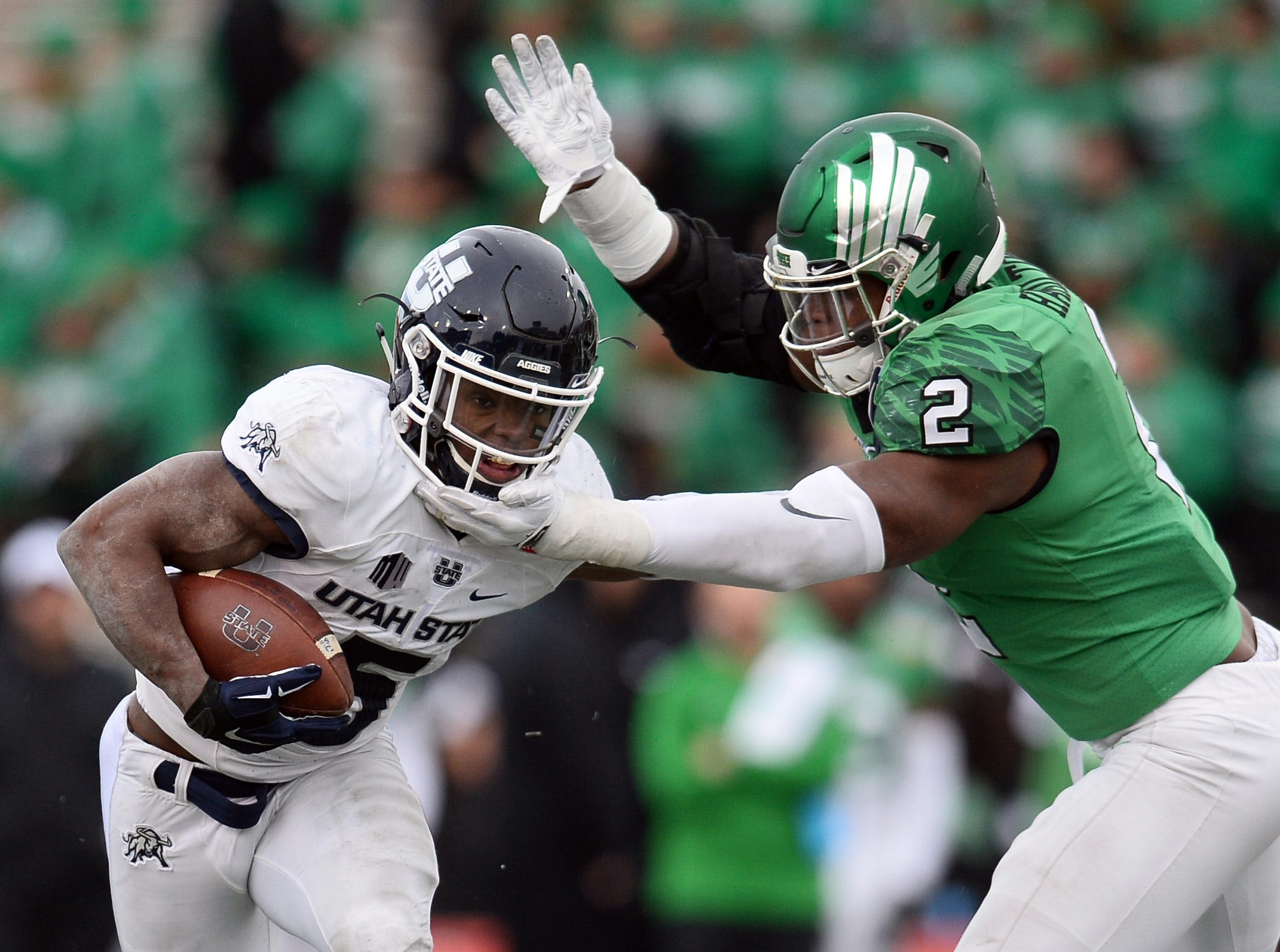 North Texas Mean Green defensive end LaDarius Hamilton (2) attempts to tackle Utah State Aggies running back Darwin Thompson (5) in the New Mexico Bowl.