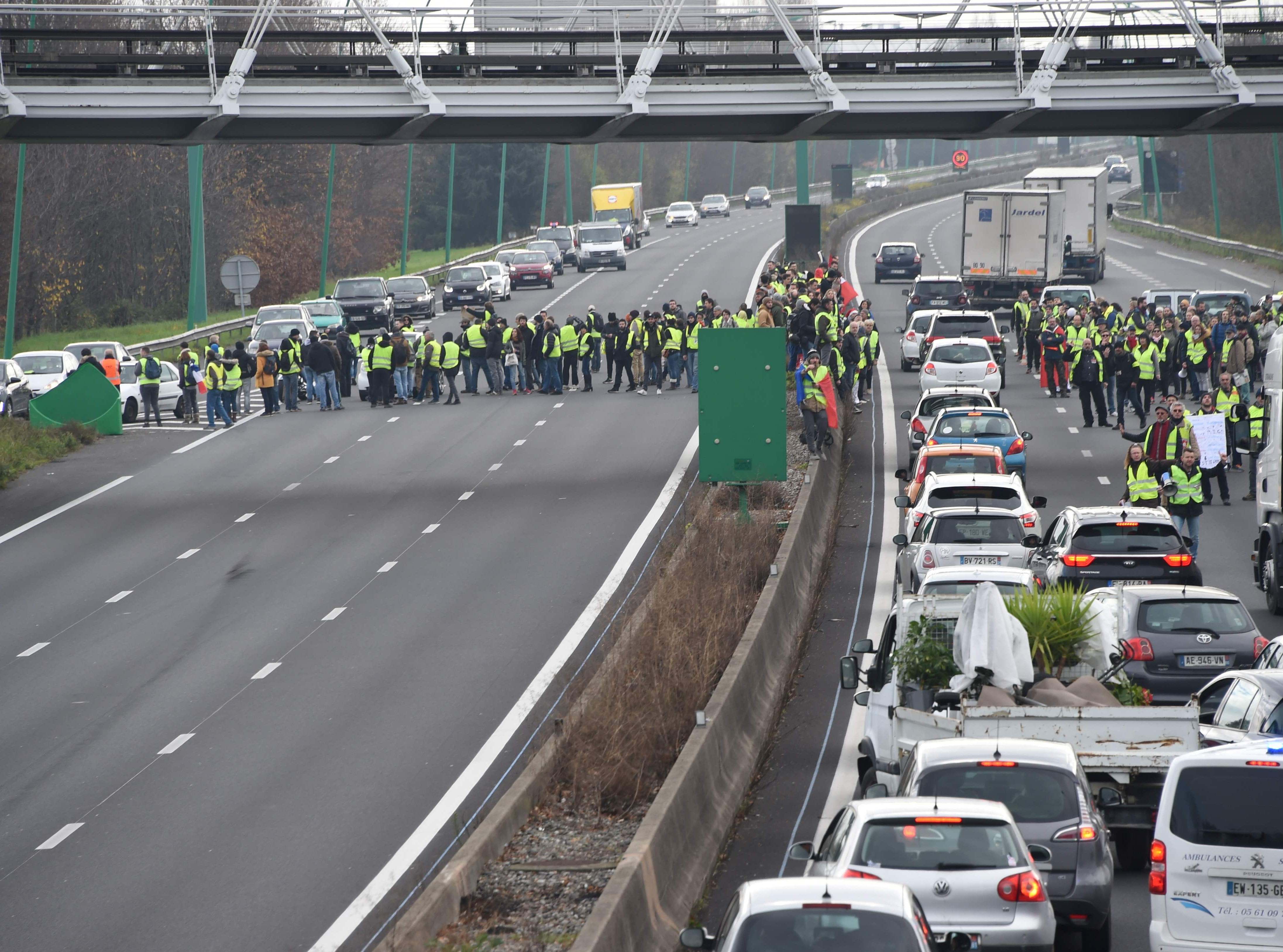 Protesters wearing yellow vests (gilets jaunes) block the ring road near La Roseraie district of Toulouse, on Dec. 15, 2018 as they demonstrate against rising costs of living they blame on high taxes.