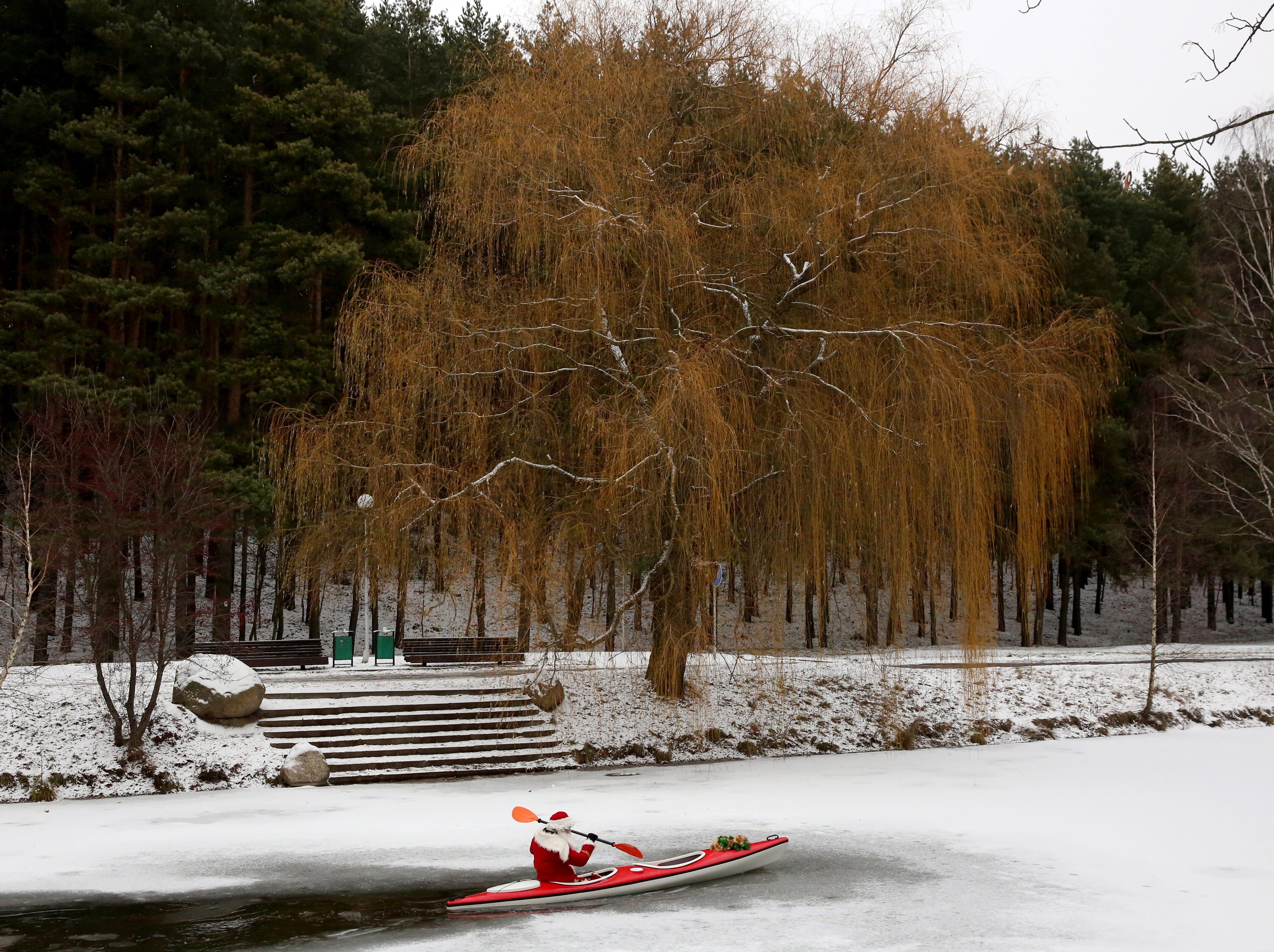 A man dressed as Santa Claus paddles a kayak in Minsk, Belarus on Dec. 15, 2018.