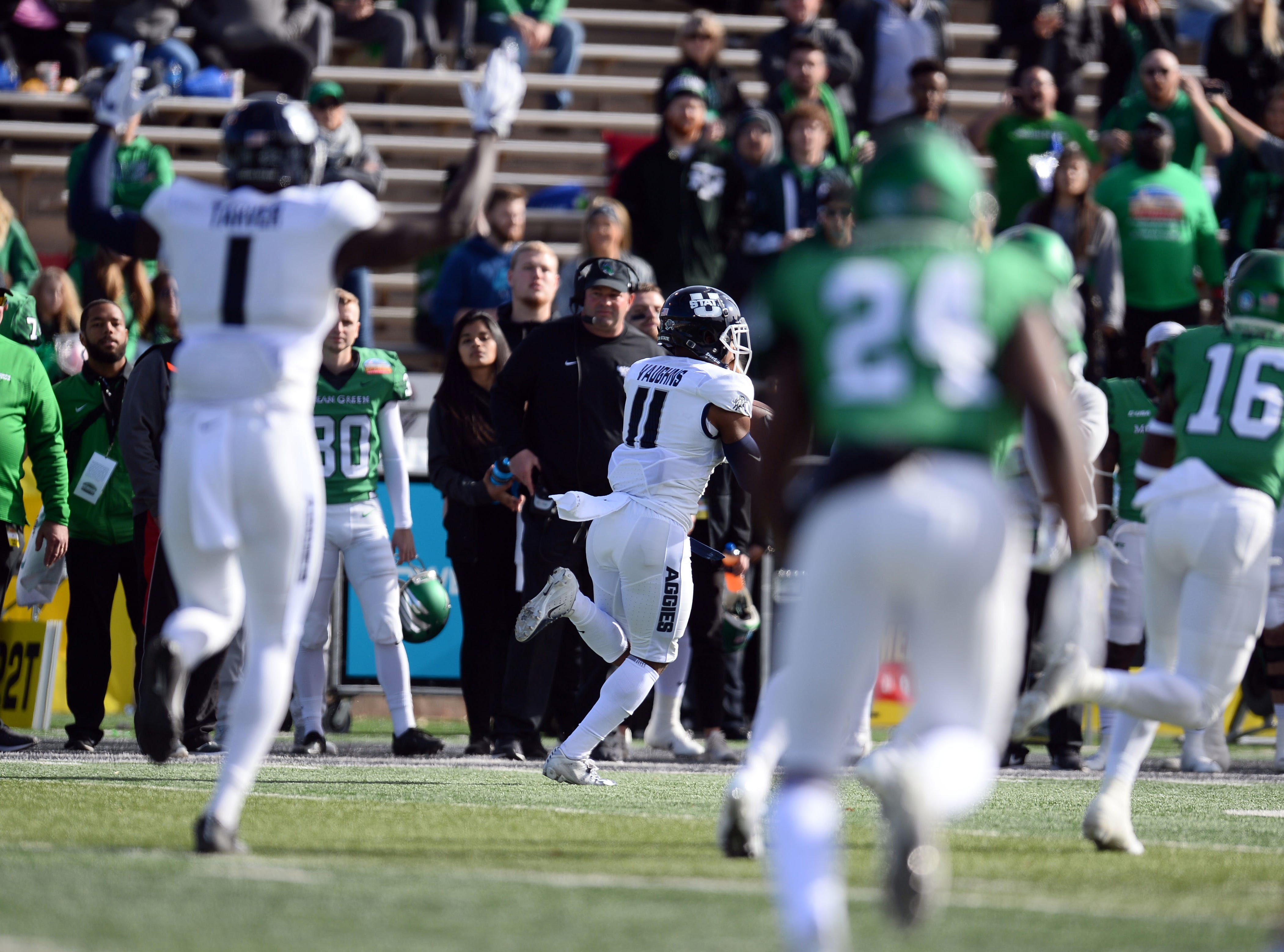 Utah State Aggies wide receiver Aaren Vaughns (11) catches a touchdown against the North Texas Mean Green in the New Mexico Bowl.