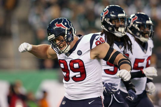 Houston Texans defensive end J.J. Watt (99) reacts after sacking New York Jets quarterback Sam Darnold (not pictured) during the first quarter at MetLife Stadium.
