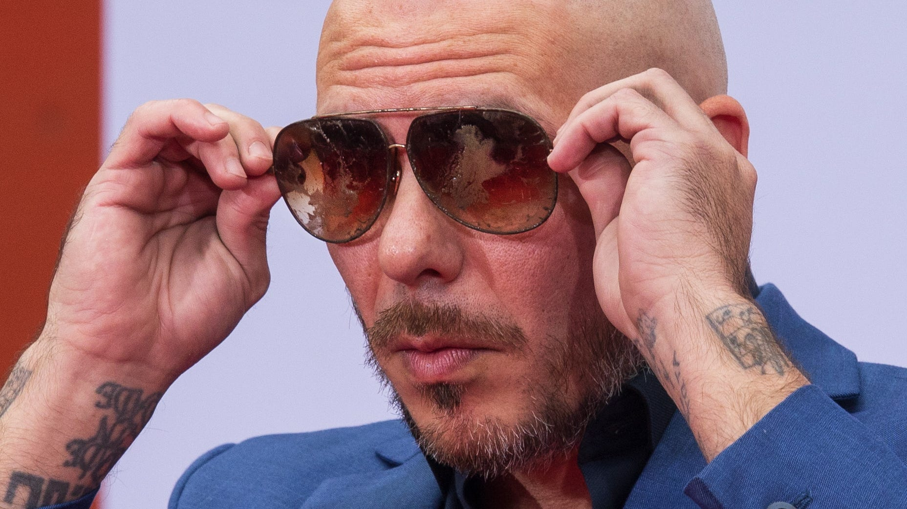 epaselect epa07231952 US musician Armando Christian 'Pitbull' Perez holds up his sunglasses after putting them in cement along with his hands and feet during a special ceremony at the TCL Chinese Theatre in Hollywood, California, USA, 14 December 2018. In celebration of the opening of the first TCL Chinese Theatre outside of Hollywood, Pitbull's cement hand and footprints will be moved to a new location in San Diego.  EPA-EFE/EUGENE GARCIA ORG XMIT: EAG09
