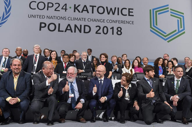 Heads of the delegations react at the end of the final session of the COP24 summit on climate change in Katowice, southern Poland, on December 15, 2018. (Photo by Janek SKARZYNSKI / AFP)JANEK SKARZYNSKI/AFP/Getty Images ORIG FILE ID: AFP_1BN06M