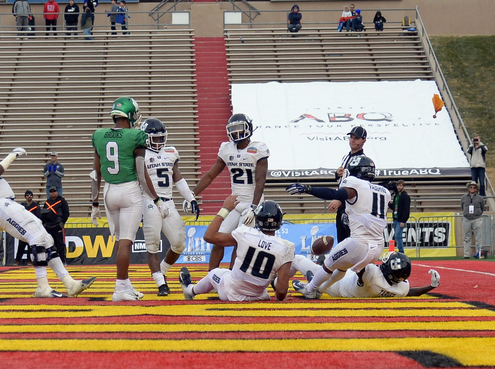 Utah State Aggies players celebrate a touchdown against the North Texas Mean Green in the New Mexico Bowl.