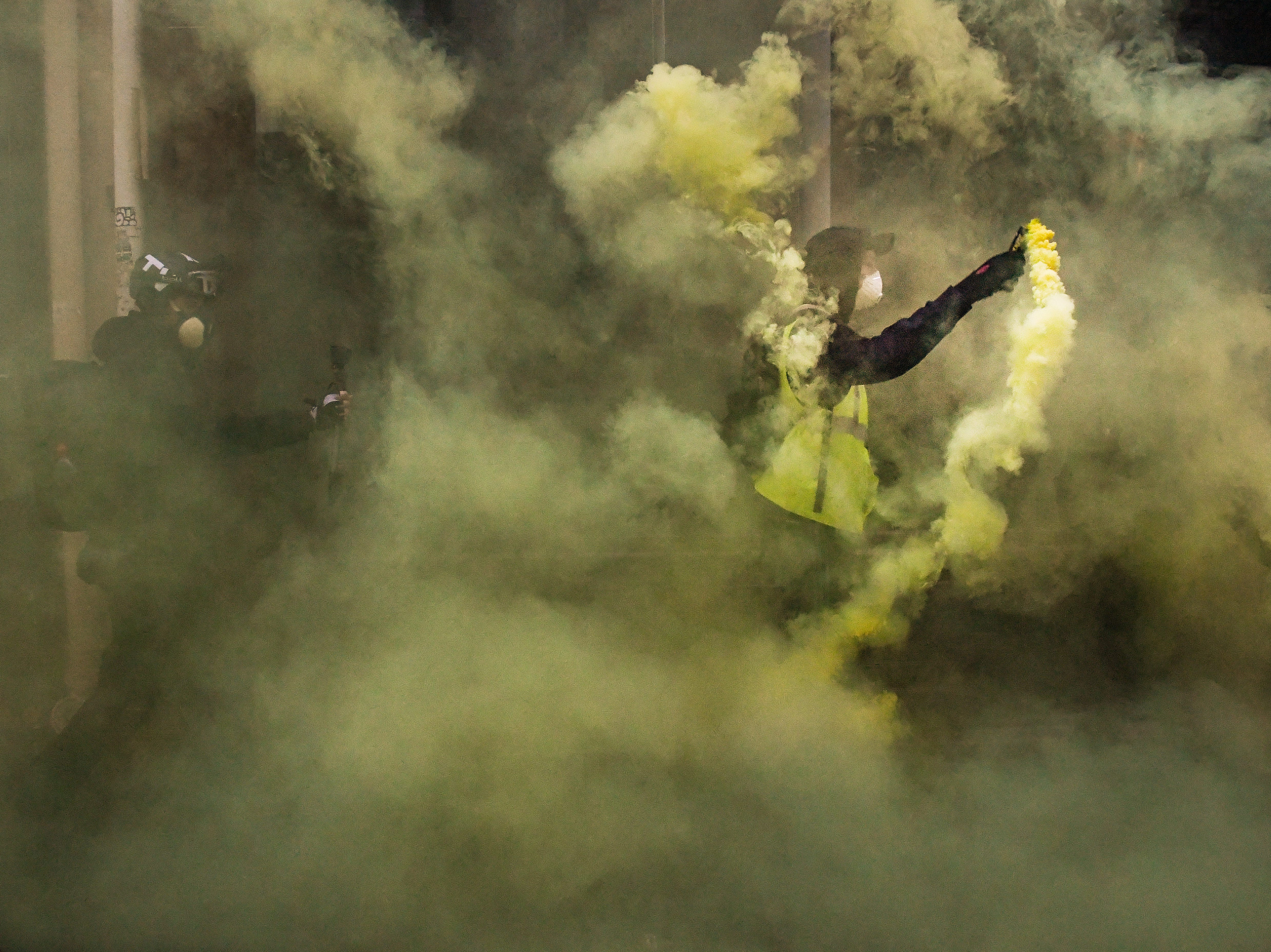 Protesters let off flares near Les Halles during the 'yellow vests' demonstration  on Dec. 15, 2018 in Paris, France. The protesters gathered in Paris for a 5th weekend despite President Emmanuel Macron's recent attempts at policy concessions, such as a rise in the minimum wage and cancellation of new fuel taxes. But the 'Yellow Vest' movement, which has attracted malcontents from across France's political spectrum, has shown little sign of slowing down.