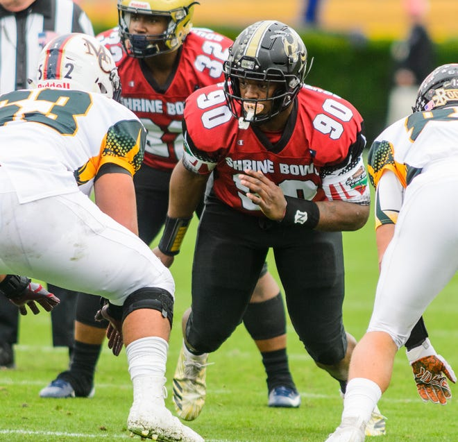T.L. Hanna defensive lineman Zacch Pickens (90) rushes the quarterback during the Shrine Bowl. Pickens was named the state's Mr. Football Saturday.