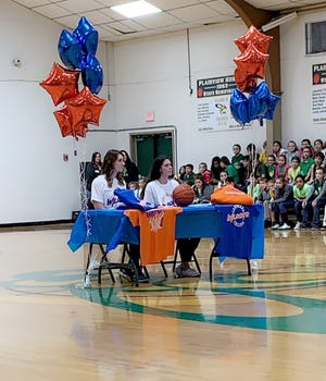 Plainview seniors Alex Harrison (left) and Allie Willis signed with Louisiana College Friday.