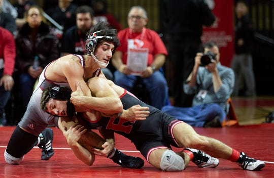 Rutgers' Nick Suriano (right) works for a takedown against Rider's Anthony Cefolo during the 133-pound bout of the Rutgers-Rider wrestling match Sunday at the Rutgers Athletic Center