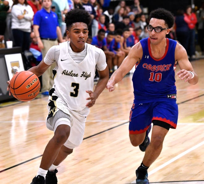 Abilene High guard Jalen McGee tries dribbling past Cooper guard Ben Thompson during Friday's crosstown basketball game at Eagle Gym Dec. 14. On Friday, McGee hit a season-high six 3-pointers against Weatherford.